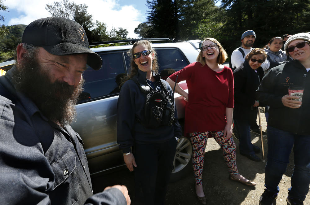 Jeannie Alexander, second from left, a medical captain with the Big Sur Volunteer Fire Brigade, enjoys a moment with other residents after she playfully touched the beard of Josh Case, left, an employee at the Ventana Inn & Spa.