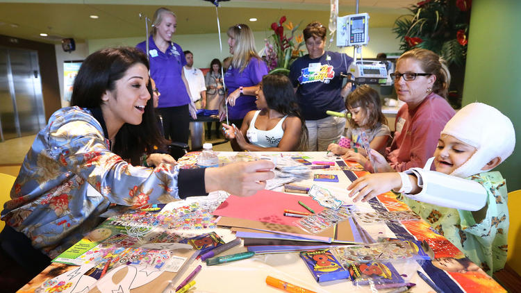 Wrestlemania superstars Big Show, Bayley delight young patients at Florida Hospital