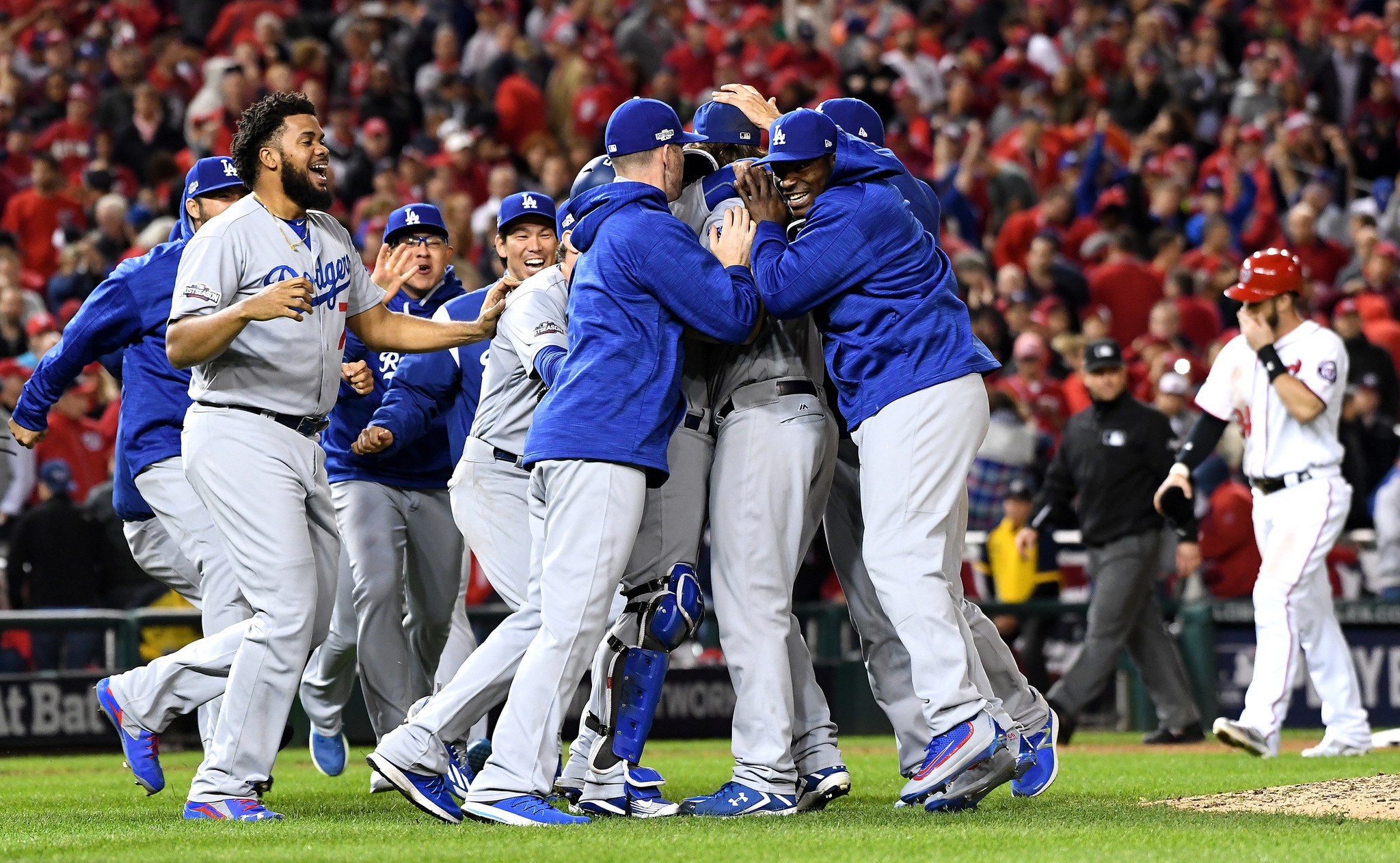 Clayton Kershaw celebrates with teamates at the end of the game in Game 5 of the NLDS in Washington D.C. in October 2016.