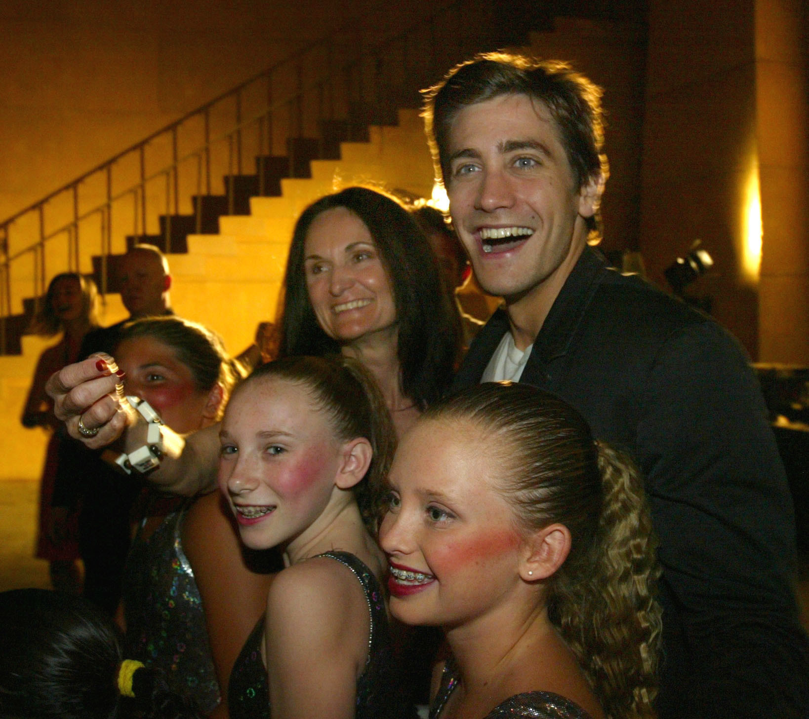 Actor Jake Gyllenhaal, right, and Beth Grant with members of the dance troupe