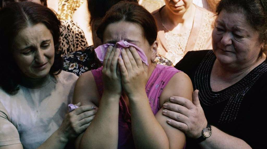 Relatives grieve for those killed during the siege in Beslan.