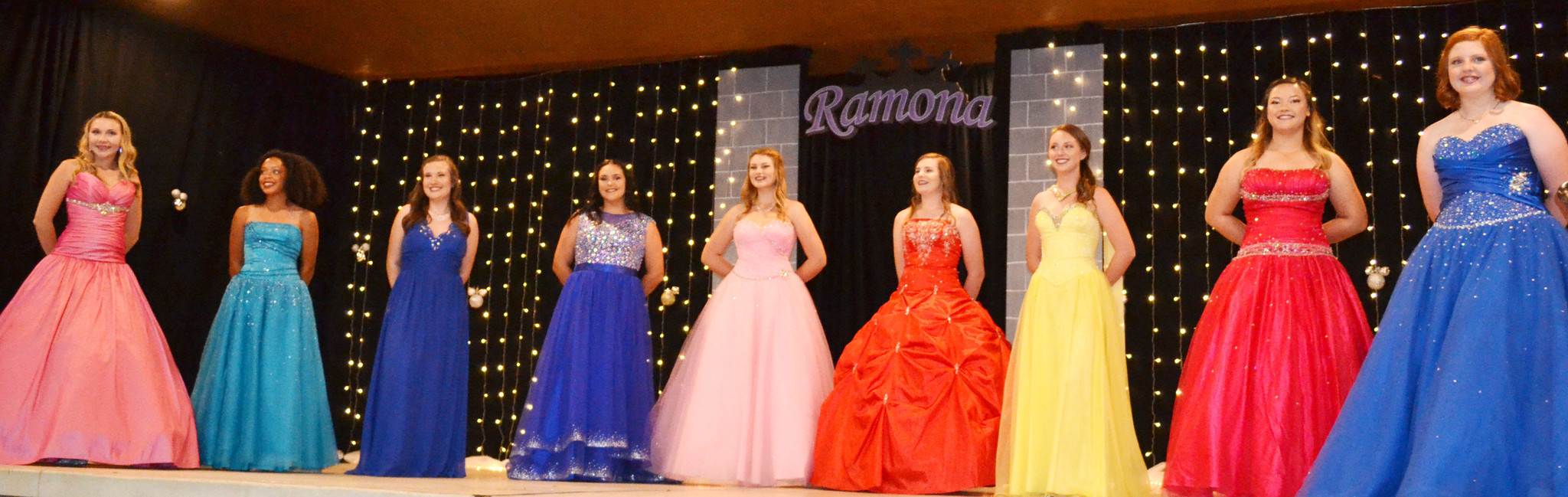 Teen Miss contestants present themselves in evening gowns. From left: Kamryn Jordan, Erika Bradley, Reigan Pozek, Cheyenne DePhillippis, Cheyenne Williams, Emily Bryant, MacKenzie Nolan, Sabrina Forehand, and Danielle Collins