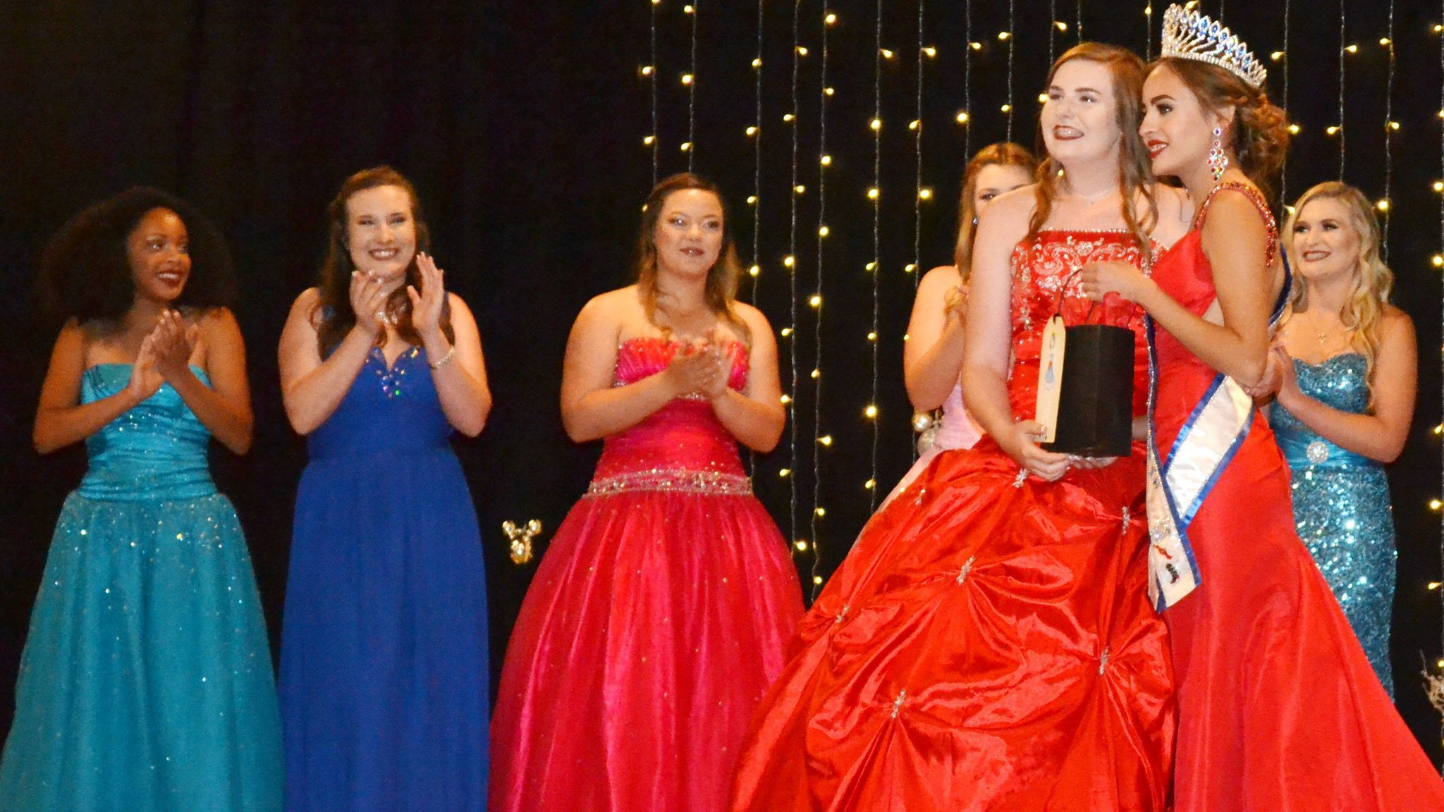 Contestant Emily Bryant wins the Teen Miss Congeniality award as presented by Teen Miss 2016 Ashley Dominguez, right.