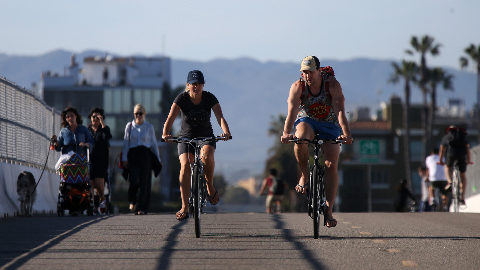 Bicyclists and walkers cross a bridge at Ocean Drive in Playa Del Rey, where the Ballona Creek Bike Path ends its seven-mile route at the Pacific Ocean.