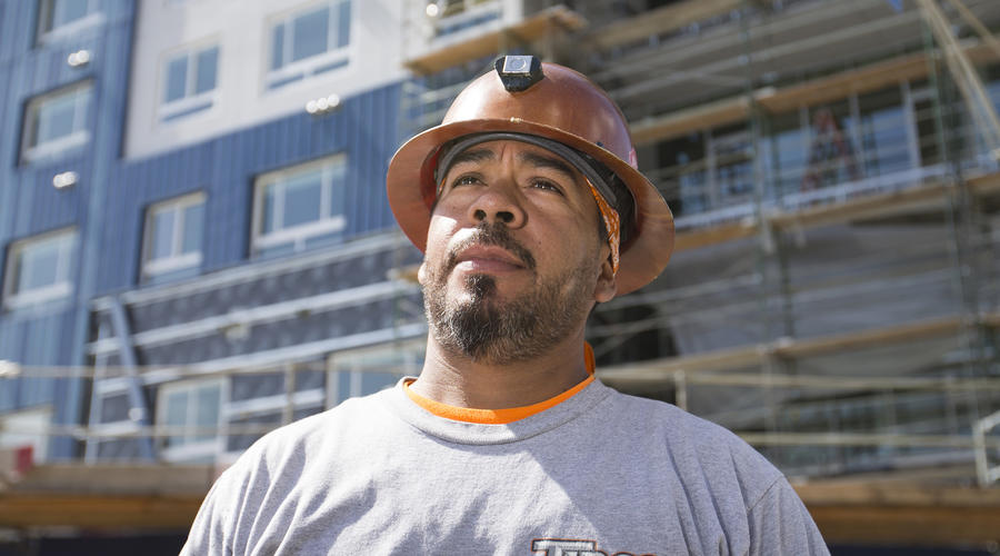 Immigrants flooded California construction. Worker pay sank. Here's why