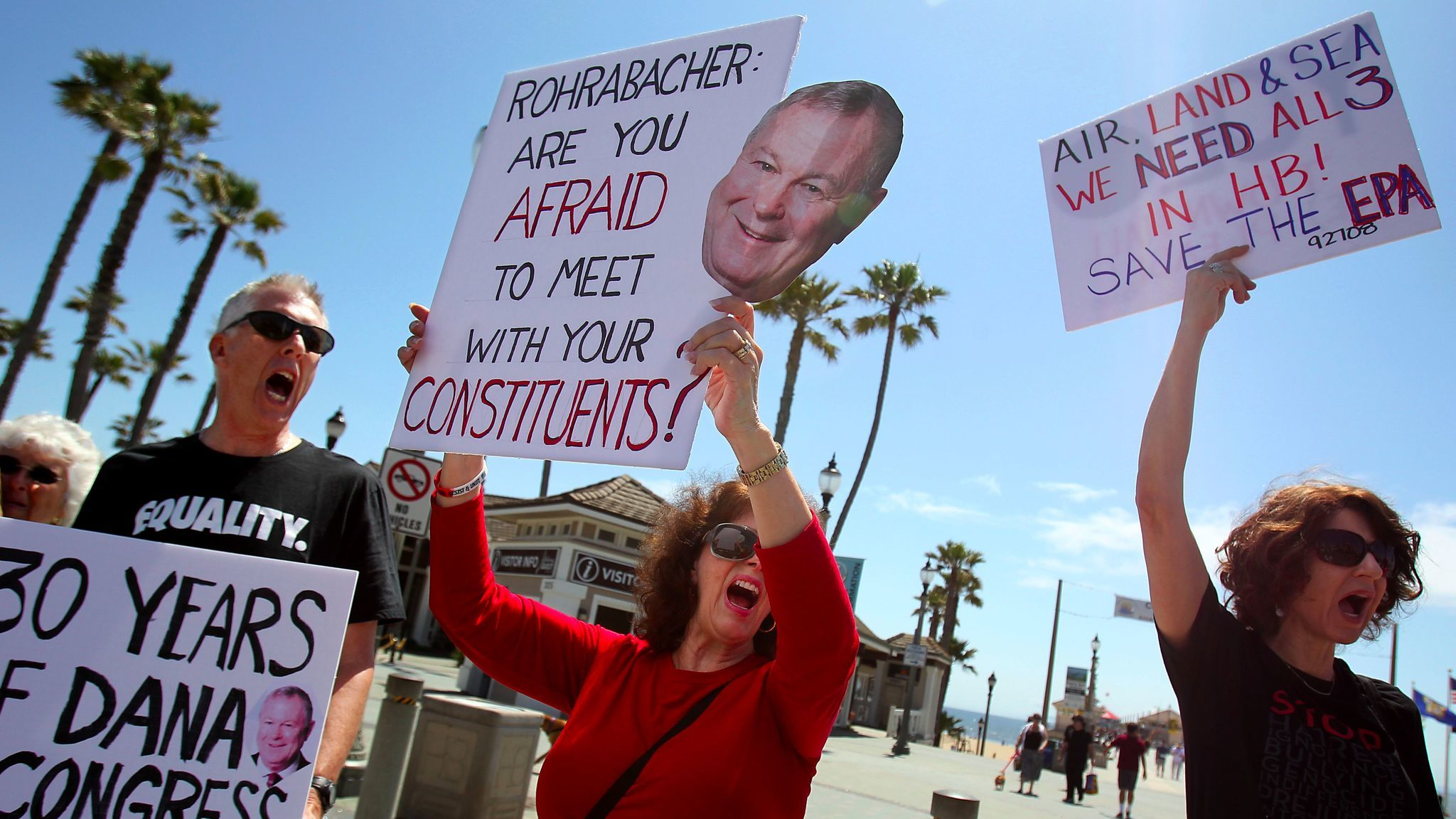 Constituents from California's 48th Congressional District protest in Huntington Beach in an effort to get Rep. Dana Rohrabacher to hold a town hall meeting.