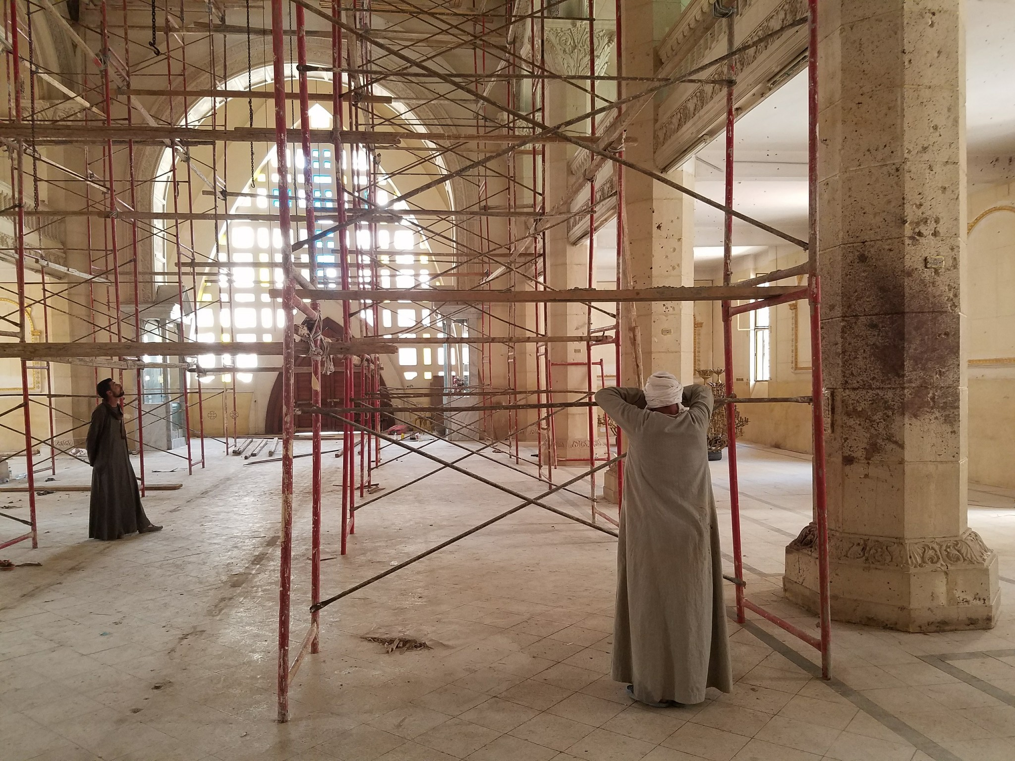 Workers repair St. George Church in Tanta, Egypt, after a bombing killed 28 people