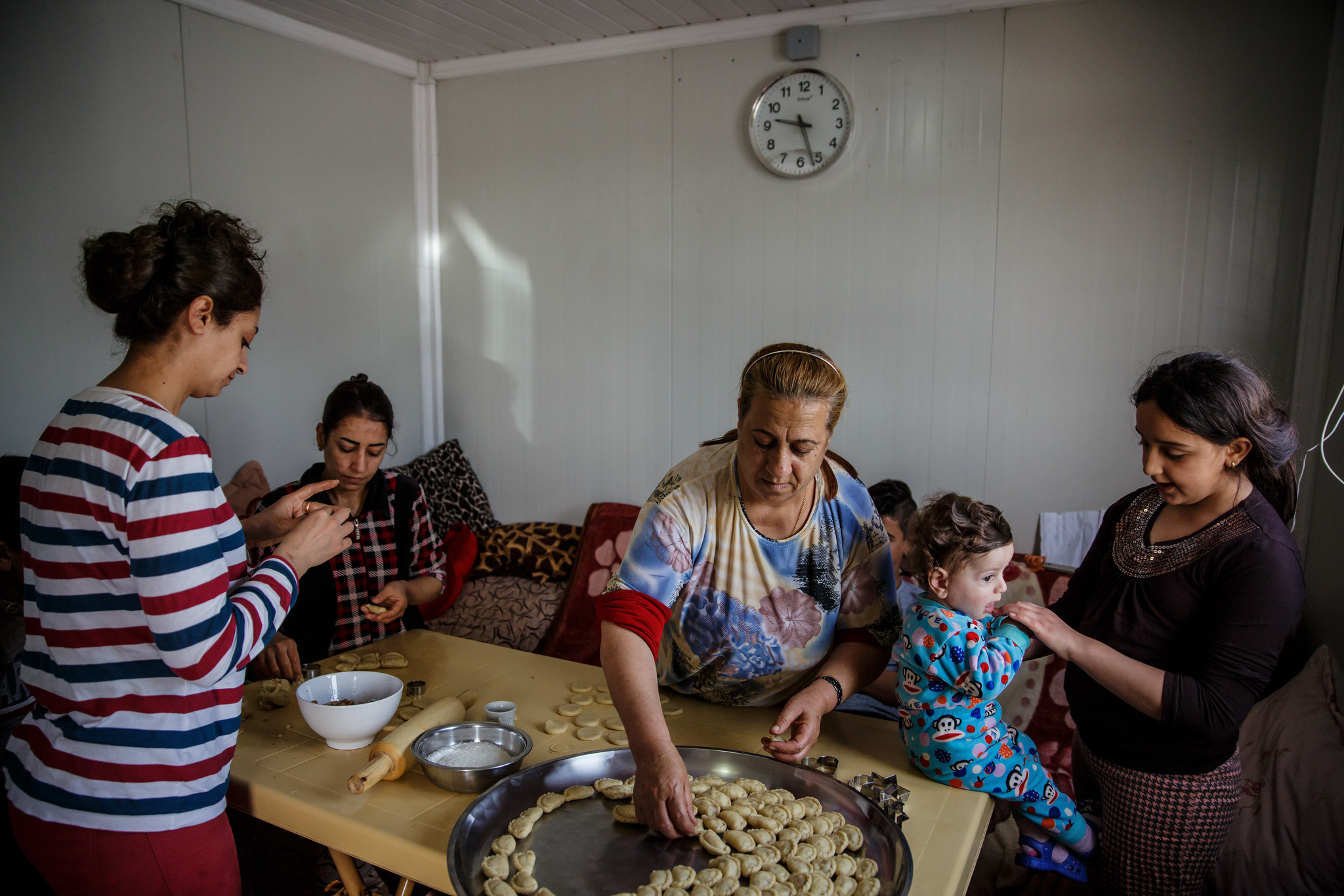 Suad Rahim makes klecha holiday cookies with her family at a Christian refugee camp in the Ainkawa neighborhood of Irbil on April 12.