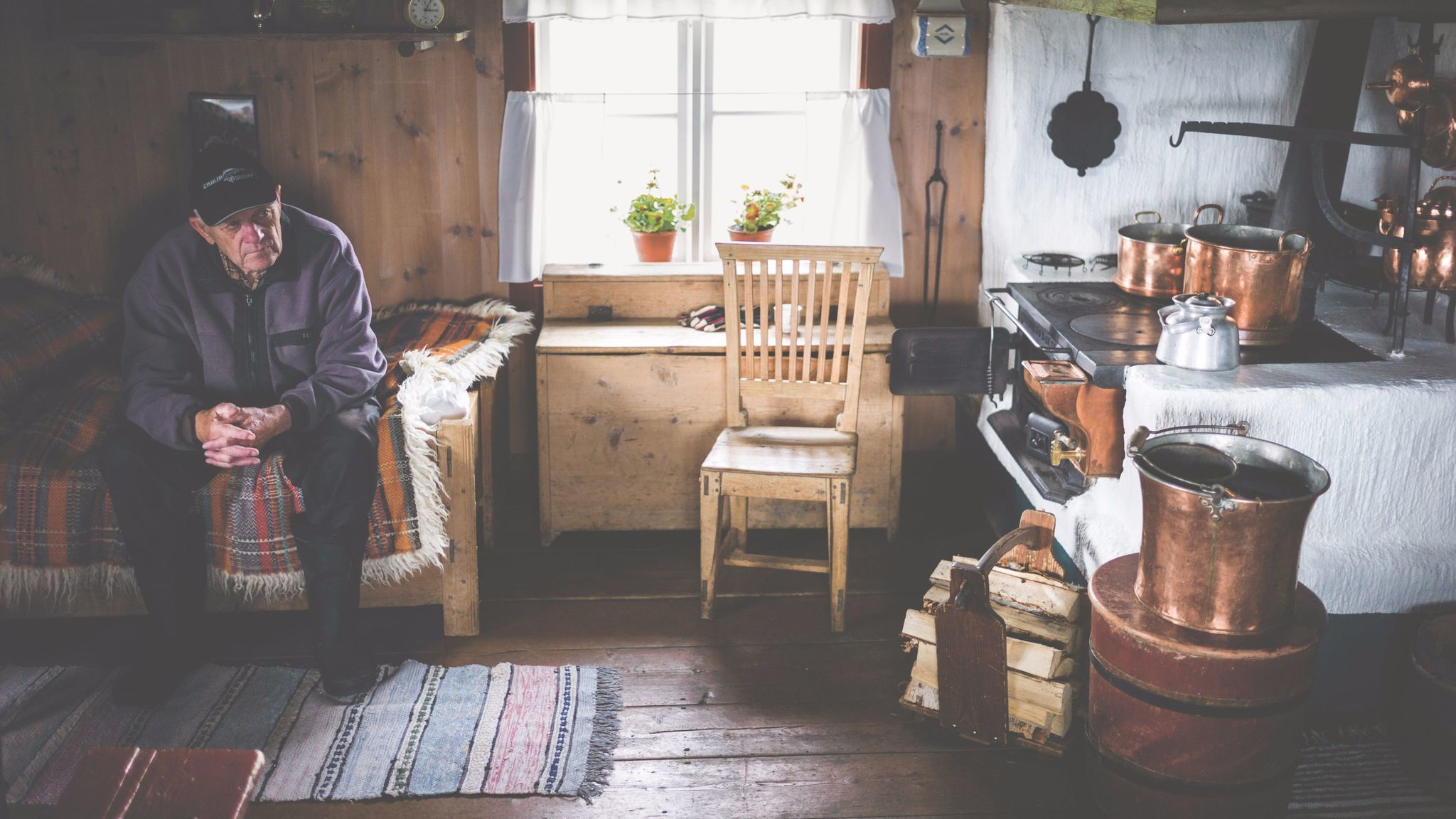 """Man in a traditional mountain farmhouse in Jamtland, Sweden, from """"The Nordic Cookbook."""""""