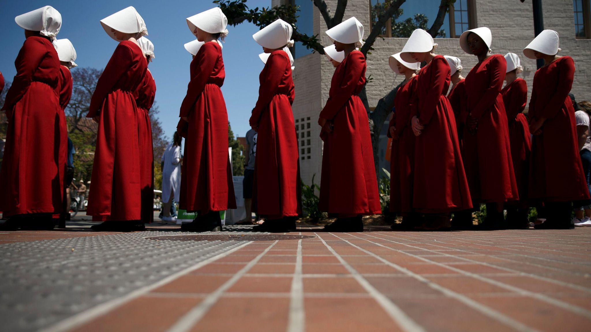 Actresses dressed as Handmaids marketing Hulu's