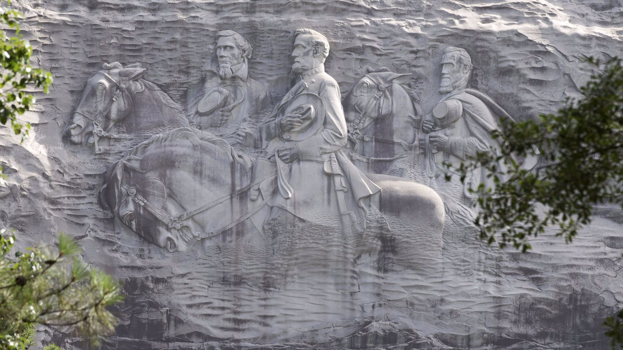 A June 23, 2015, photo shows a carving depicting Confederates Stonewall Jackson, Robert E. Lee and Jefferson Davis in Stone Mountain, Ga.