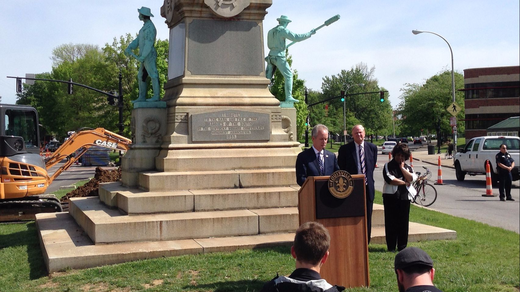 Louisville, Ky., Mayor Greg Fischer speaks in front of a Confederate monument near the University of Louisville on April 29, 2016.