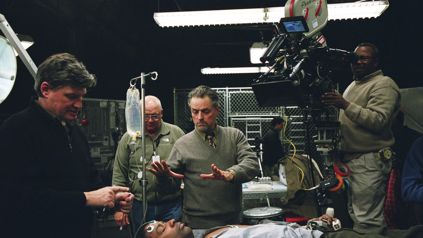 "Director Jonathan Demme, center, frames a shot of Denzel Washington on the set of 2004's ""The Manchurian Candidate"""