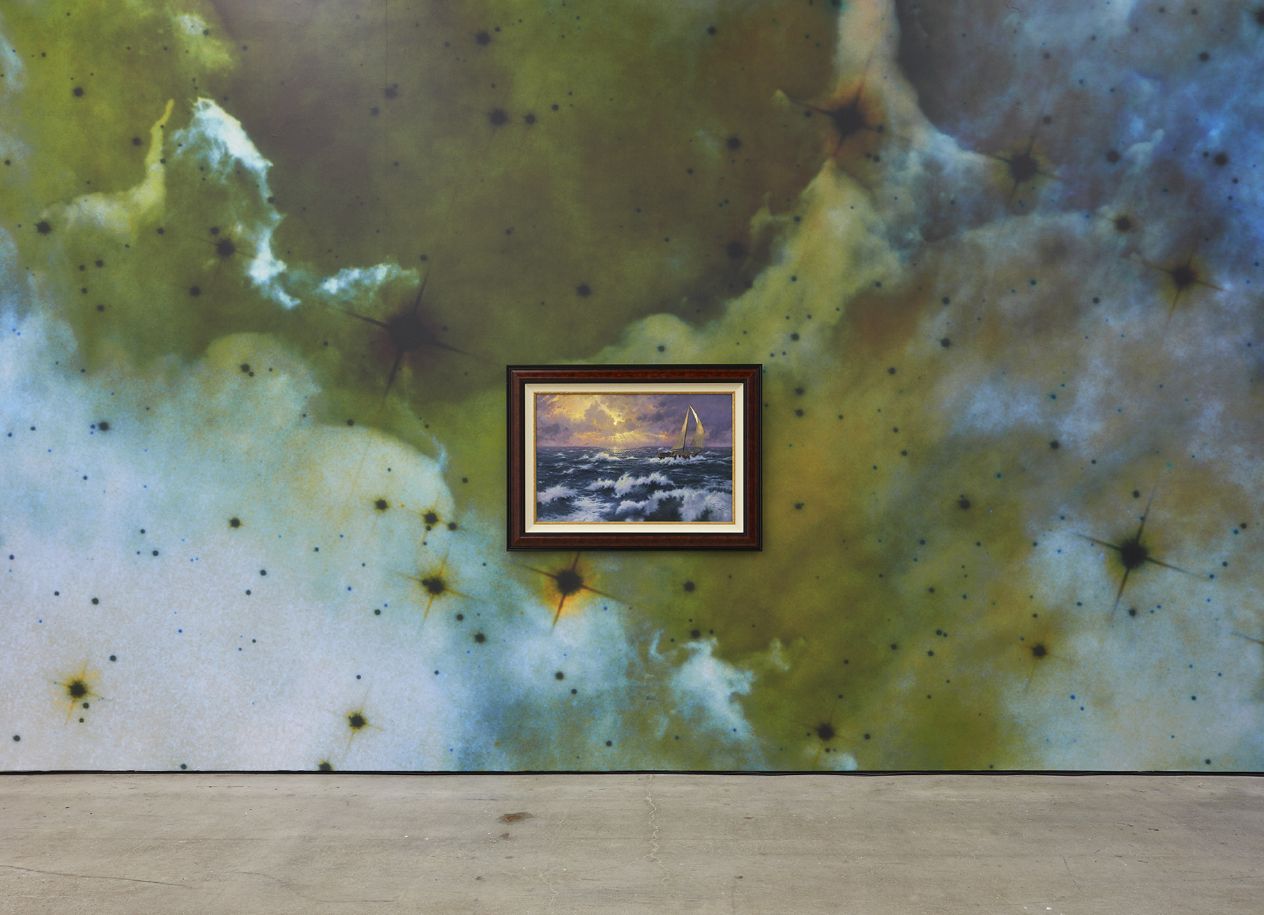 A painting by Thomas Kinkade on cosmic photographic wallpaper by Mungo Thomson at Nicodim Gallery.