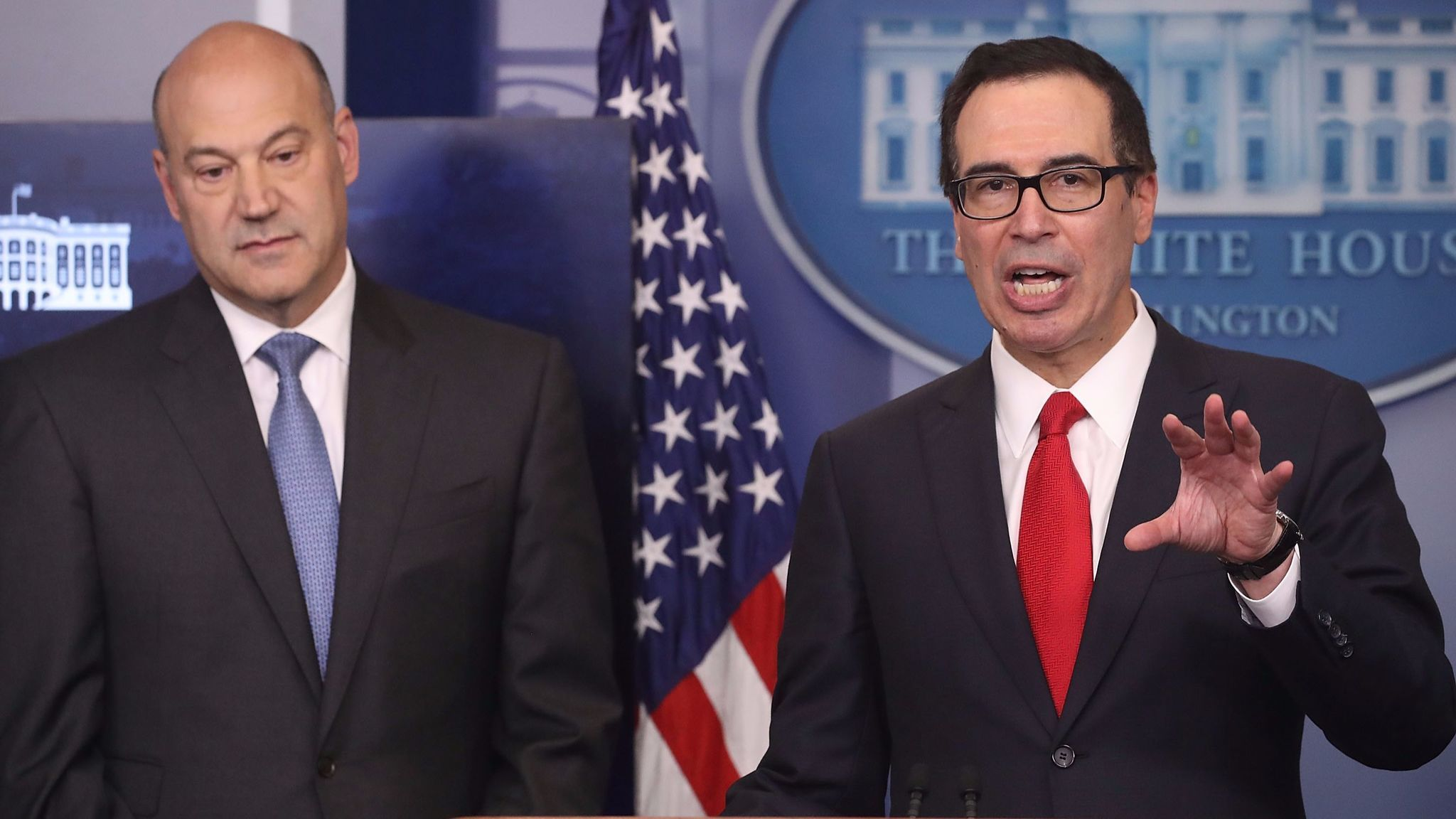 Gary Cohn, director of the White House National Economic Council, left, and Treasury Secretary Steven T. Mnuchin speak to reporters about President Trump's tax plan on Wednesday at the White House.