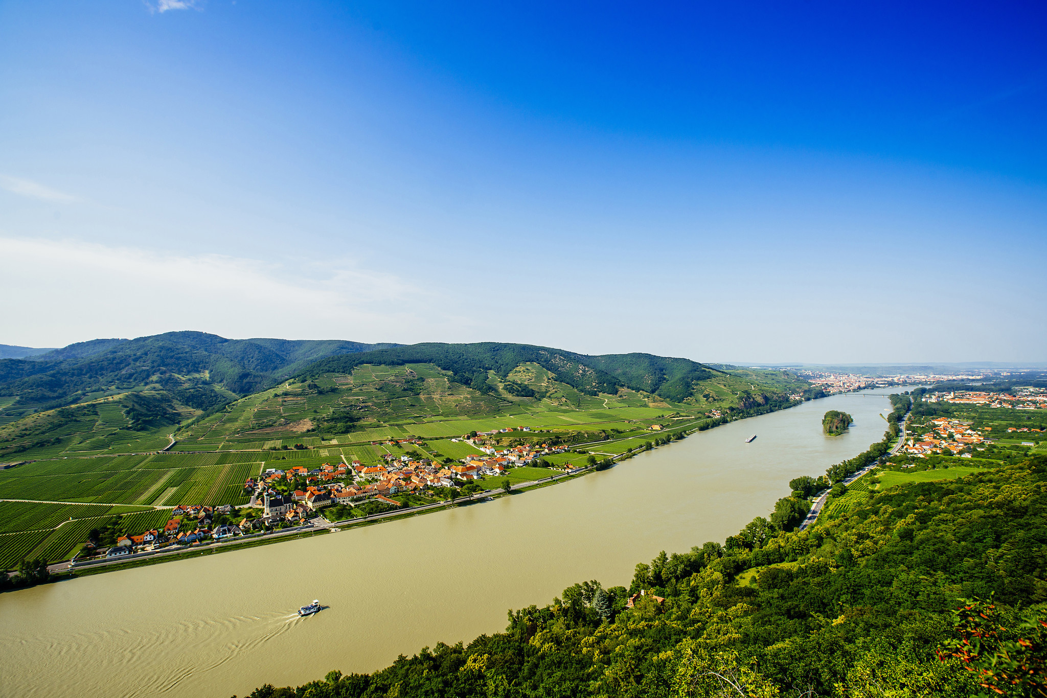 The path of the Danube River goes through lush scenery in the hills of Austria.