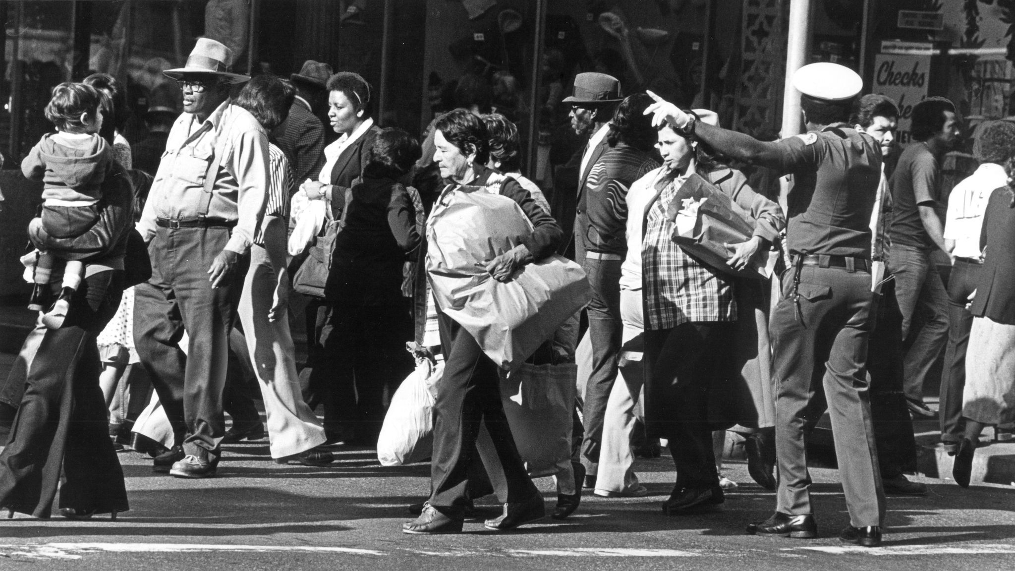 Shoppers fill a sidewalk in downtown Los Angeles in 1980.