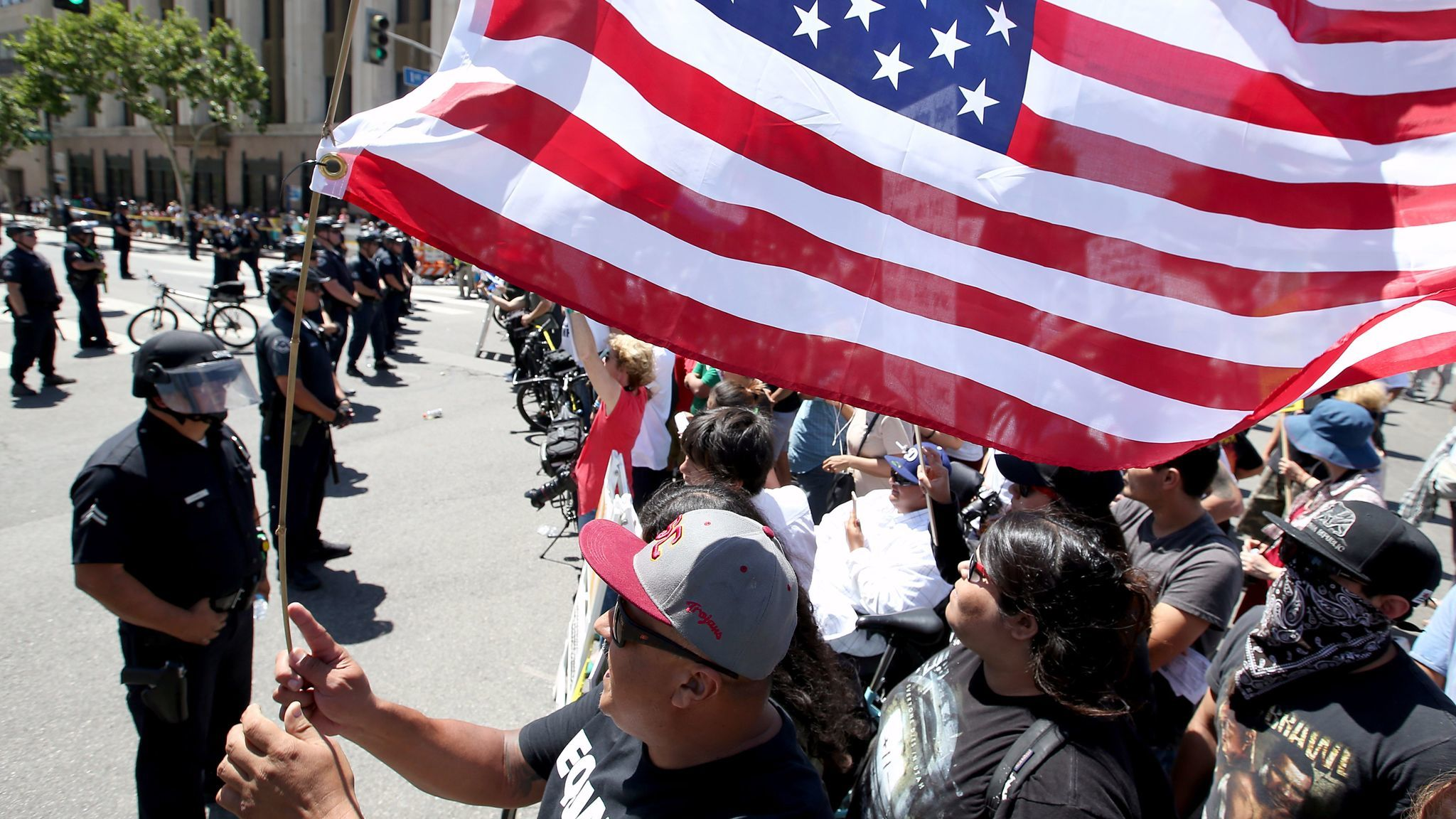 Anti-Trump protesters yell across the street at supporters of the president as separate May Day marches and rallies converge at 1st and Spring streets in downtown Los Angeles.