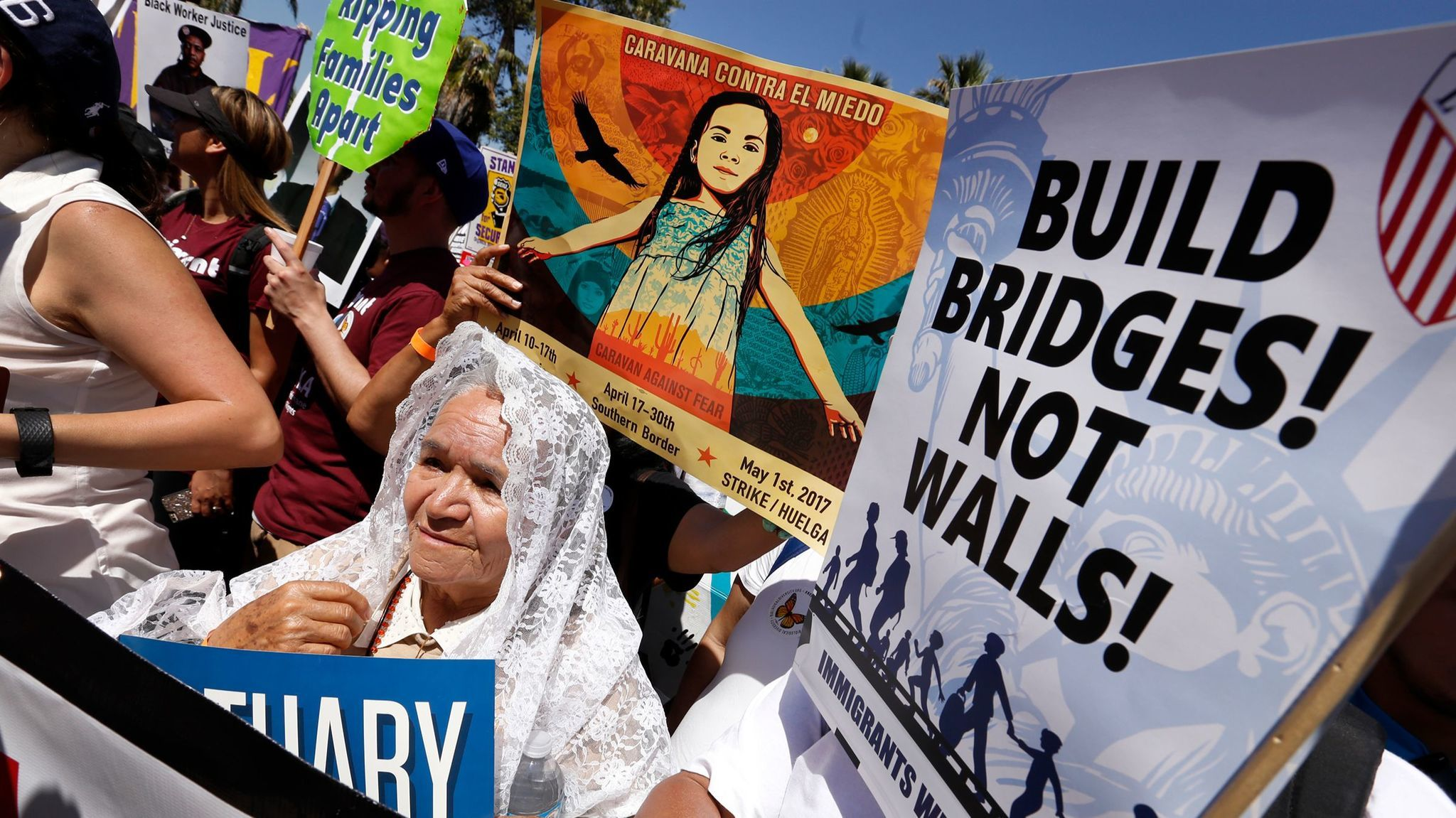 Bertha Ramirez, 72, of Fresno, came to march with thousands against President Trump's vowed crackdown on illegal immigration.