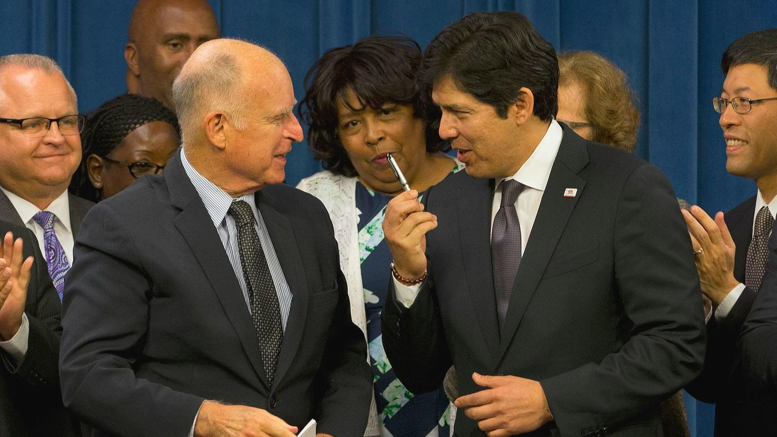 "After long negotiations, Gov. Jerry Brown and state Senate leader Kevin de León came to a compromise on the ""sanctuary state"" bill. (Rich Pedroncelli / Associated Press)"
