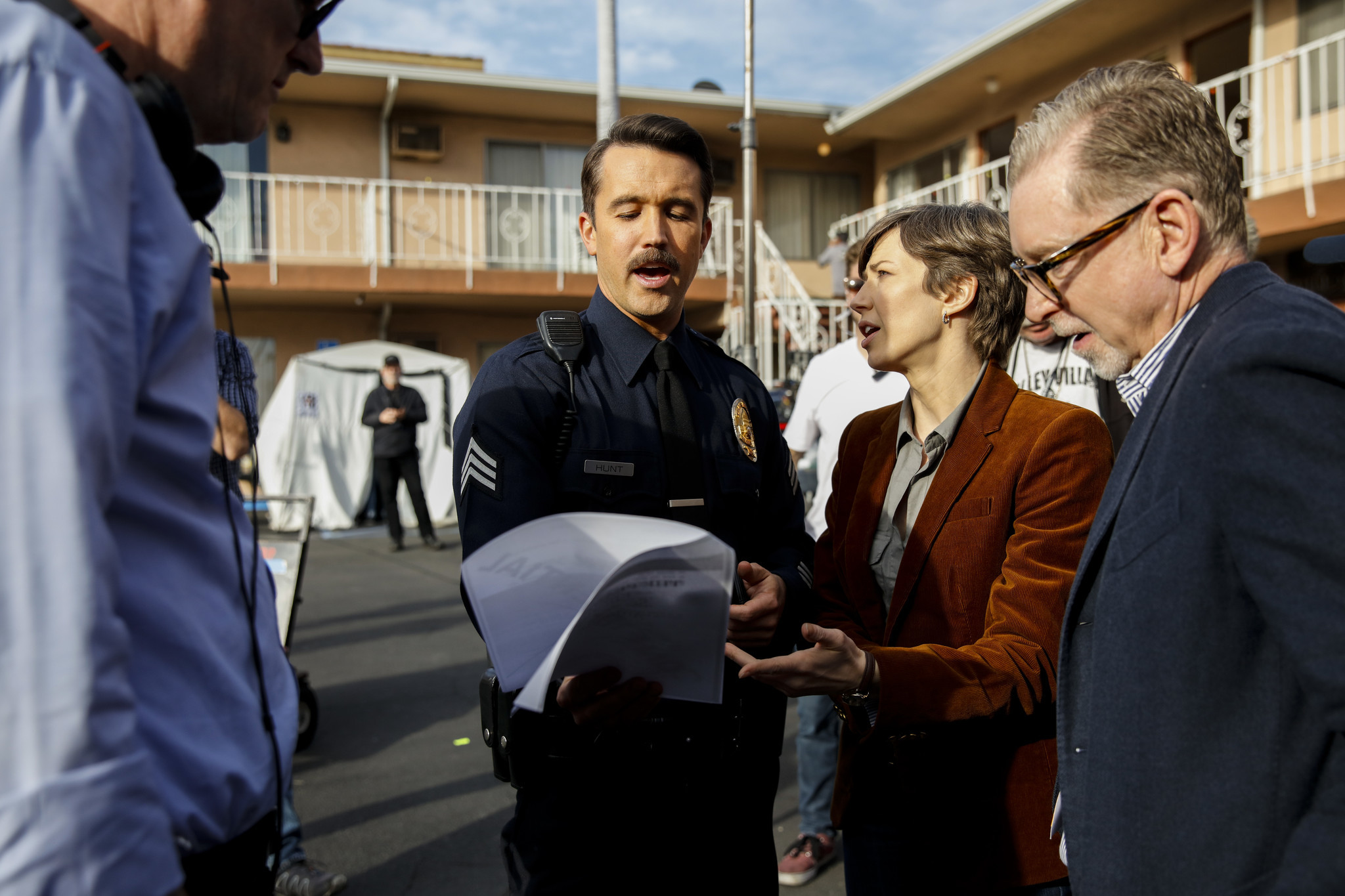 Director John Cameron, left, and producer Warren Littlefield, right, frame actors Rob McElhenney and Carrie Coon after concluding a day of filming, on the set of FX's Season 3 of