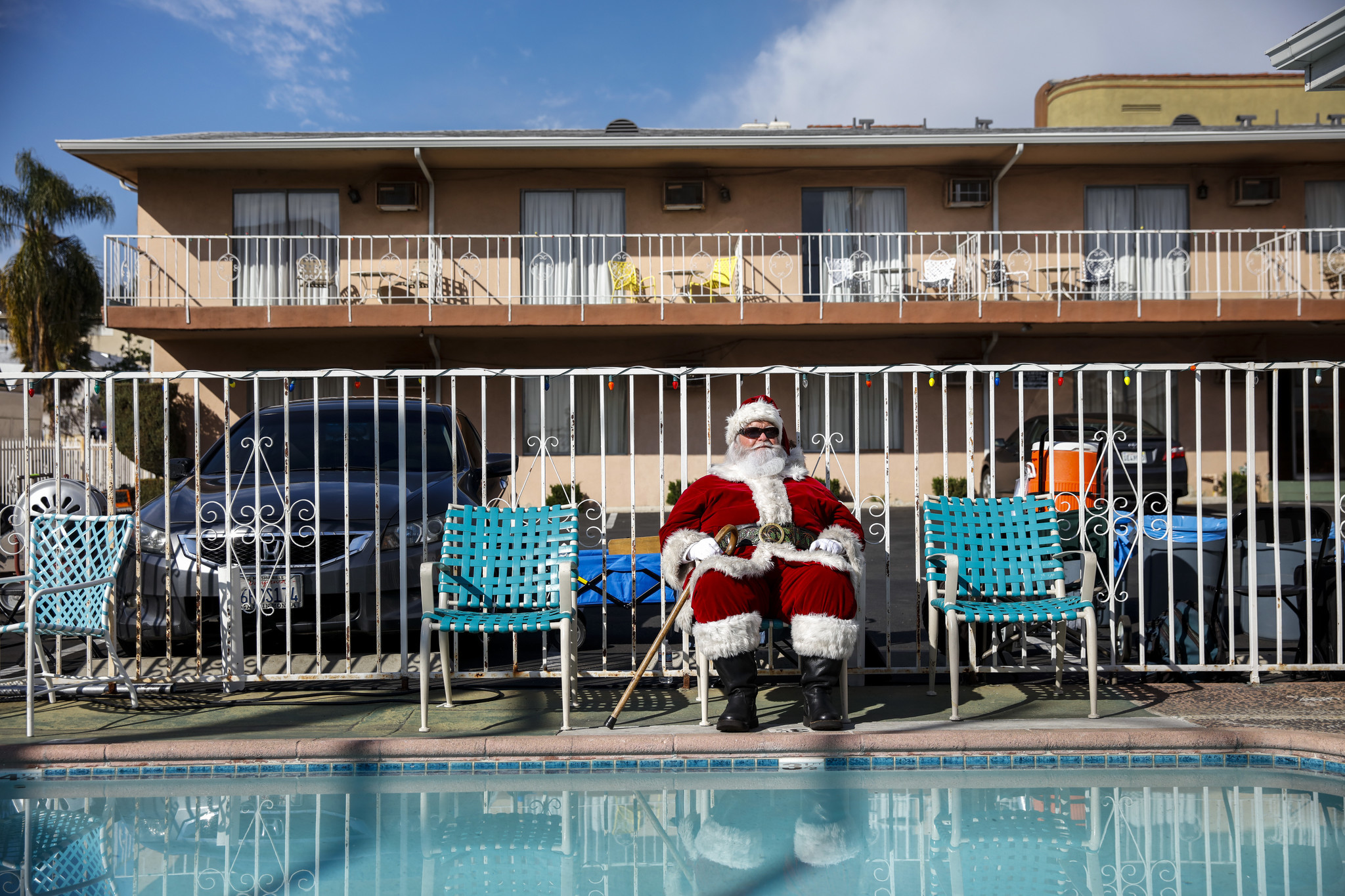 An actor in a Santa costume gets in his