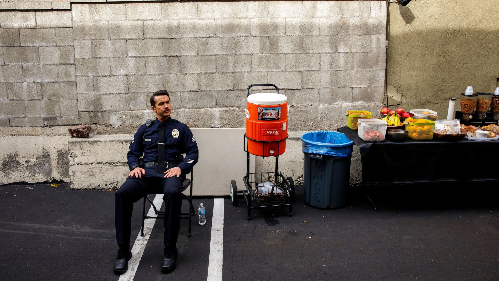 Actor Rob McElhenney, in costume, during a break from shooting a scene on FX's