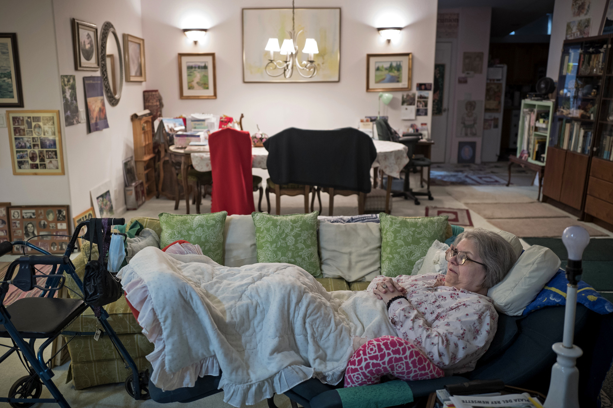 Sharis Woodard, a retired schoolteacher who has lived in Plaza del Rey since 1986, reclines in her living room. In addition to space rent, Woodard also has a mortgage.
