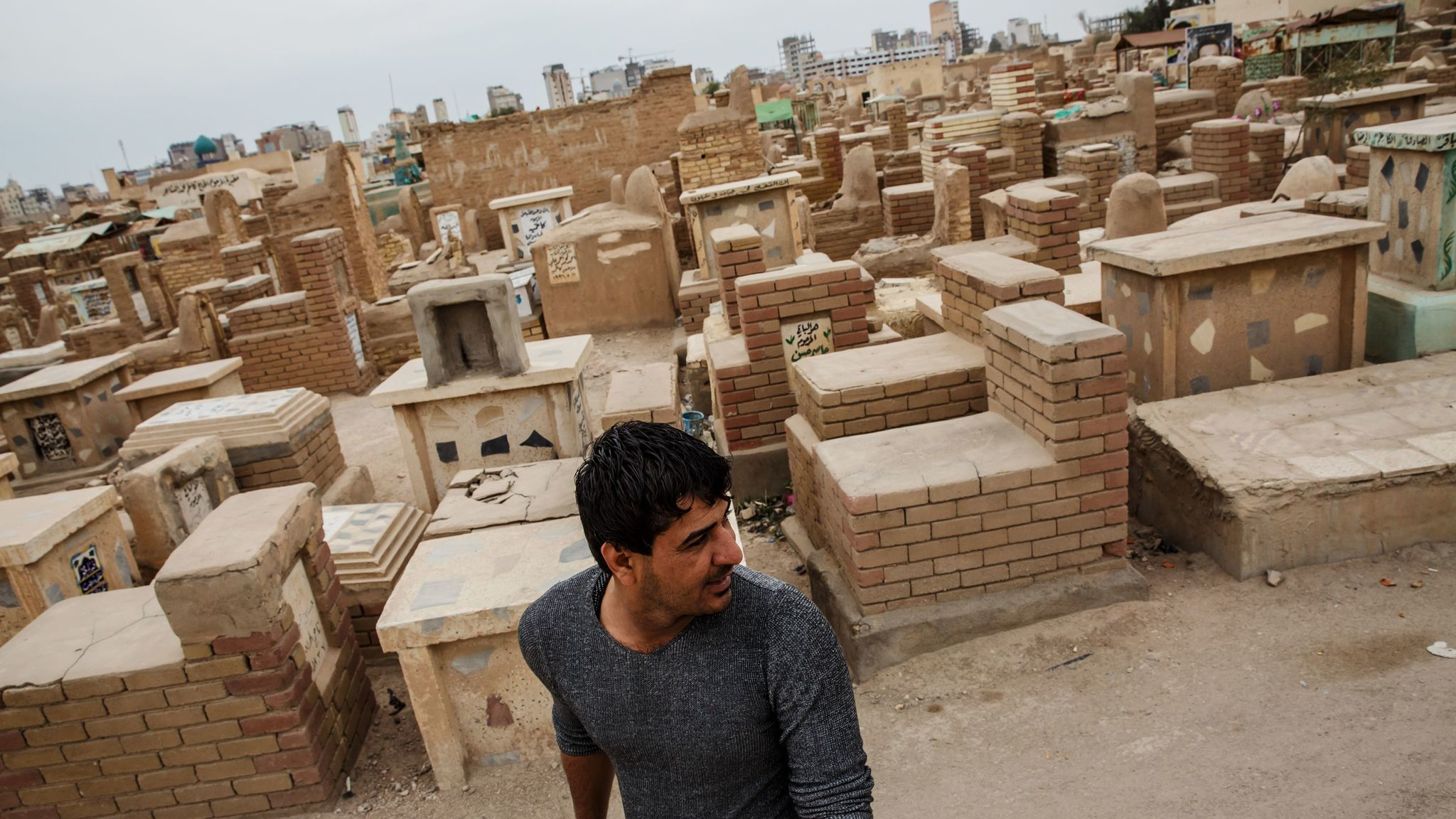 Wissam Daoud visits the holy city of Najaf to pray at a burial ground full of Shiite Muslim comrades who died fighting Islamic State.