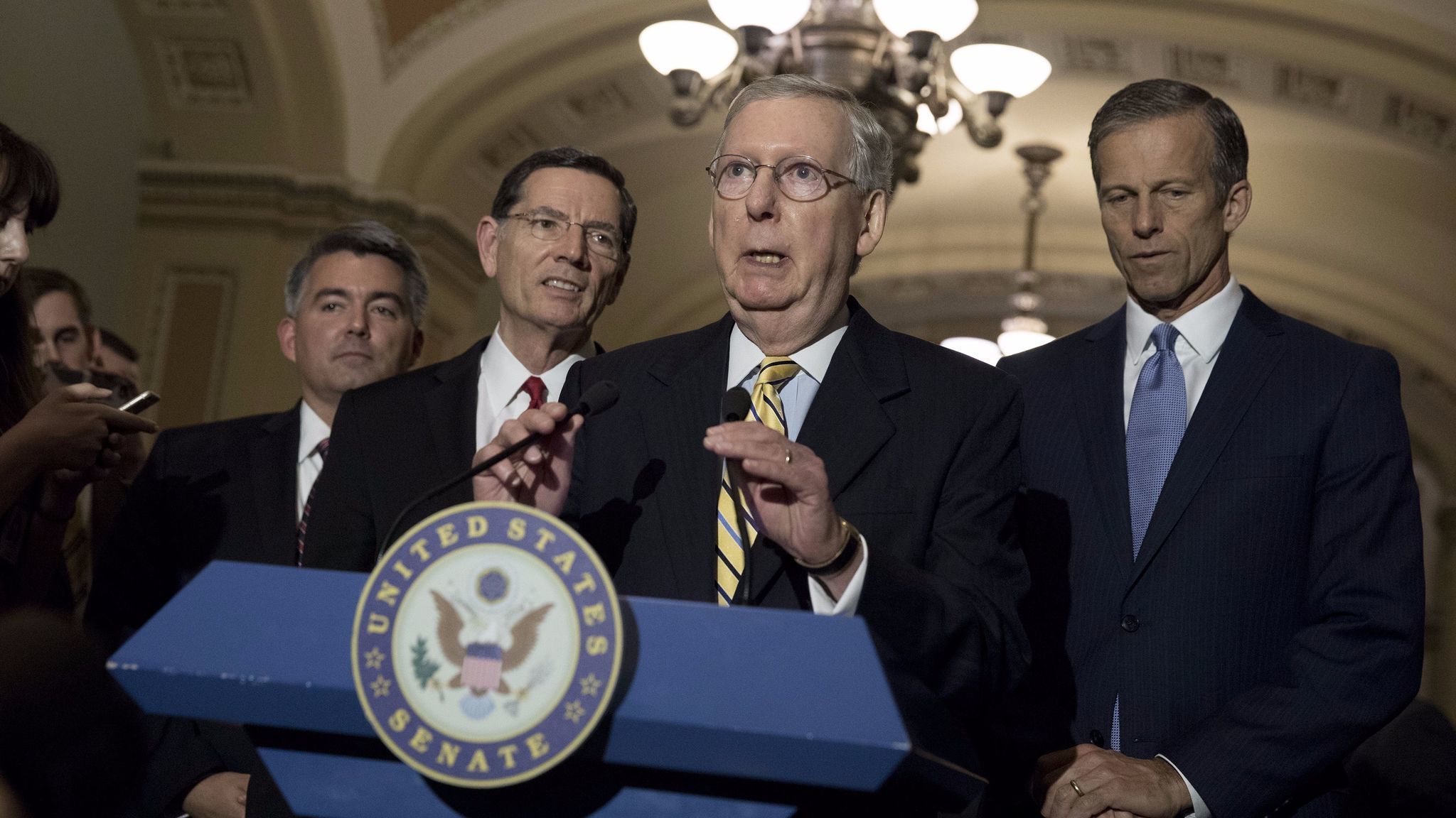 Senate Majority Leader Mitch McConnell (R-Ky.), flanked by Sen. Cory Gardner (R-Colo.), Sen. John Barrasso (R-Wyo.) and Sen. John Thune (R-S.D.), speaks to the media about the recent spending bill that averted a government shutdown.