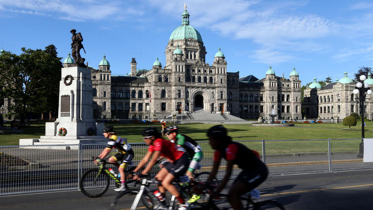 The Legislative Assembly of British Columbia, as a bike race goes on in the early morning.