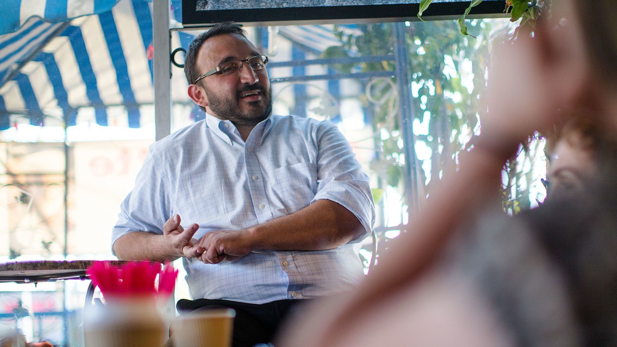Karo Torossian meets with District 7 residents last week at a coffee shop in Sylmar.