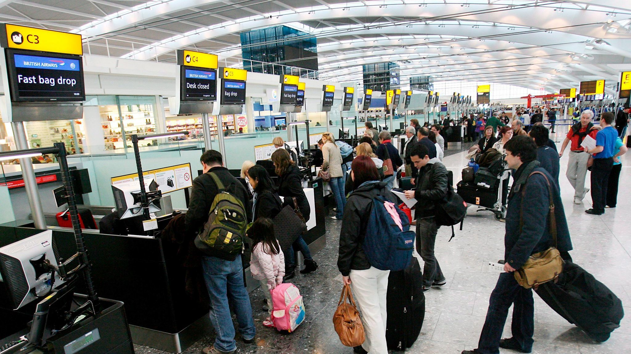 British Airways customers check in at Heathrow Airport's Terminal 5 in London. A service called Heathrow VIP inspired the private terminal at Los Angeles International Airport.