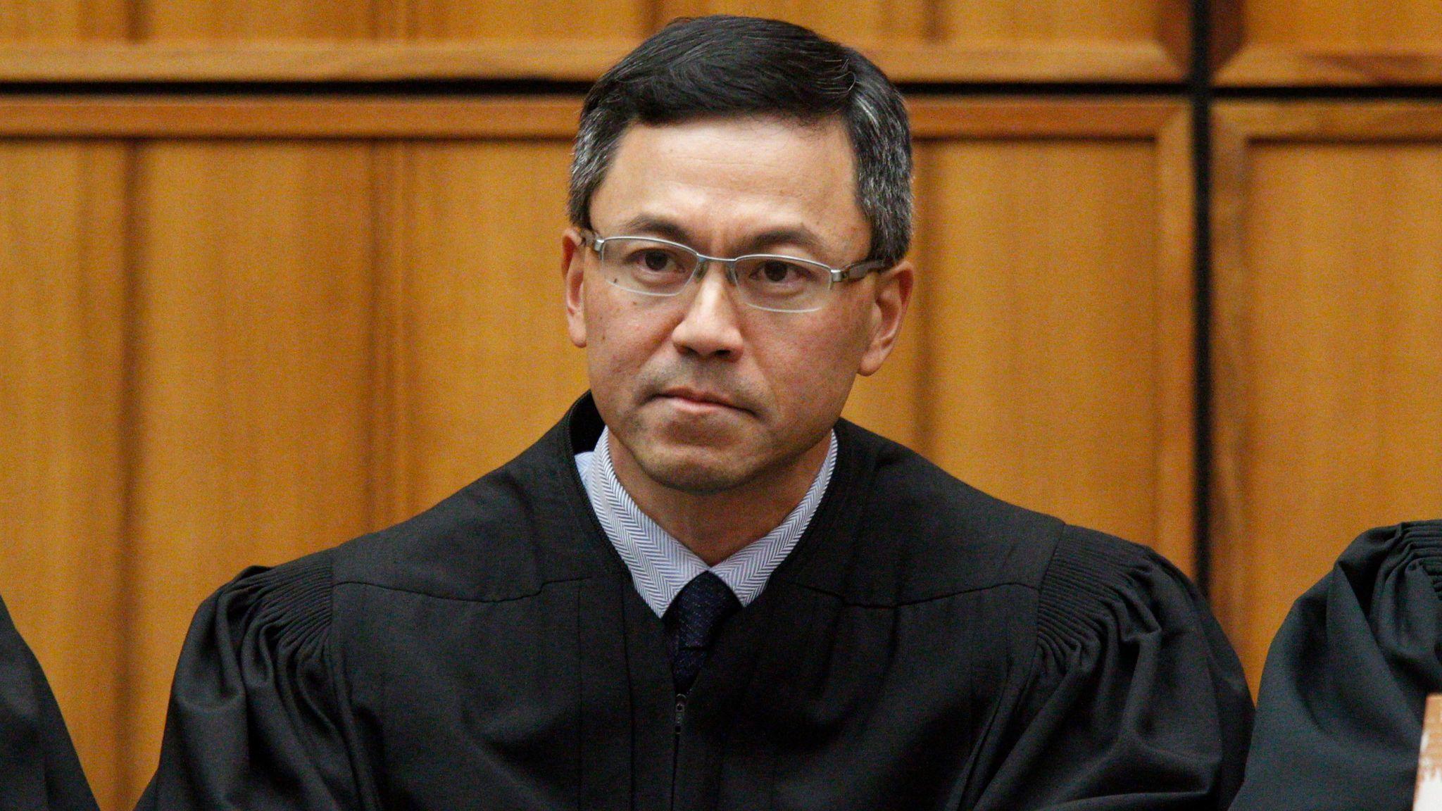 A December 2015 file photo shows U.S. District Judge Derrick Watson in Honolulu.