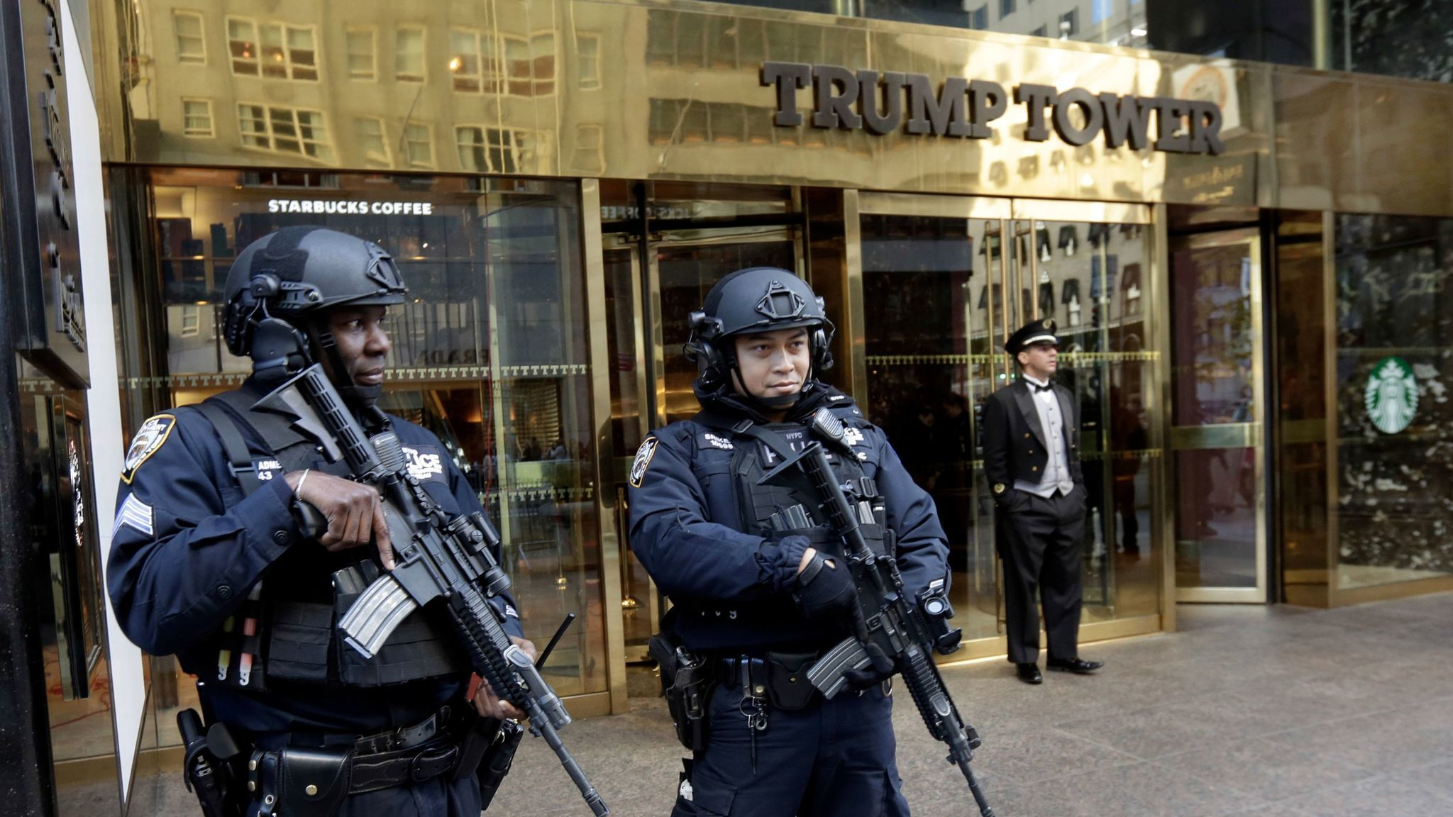 New York police officers guard the front of Trump Tower.