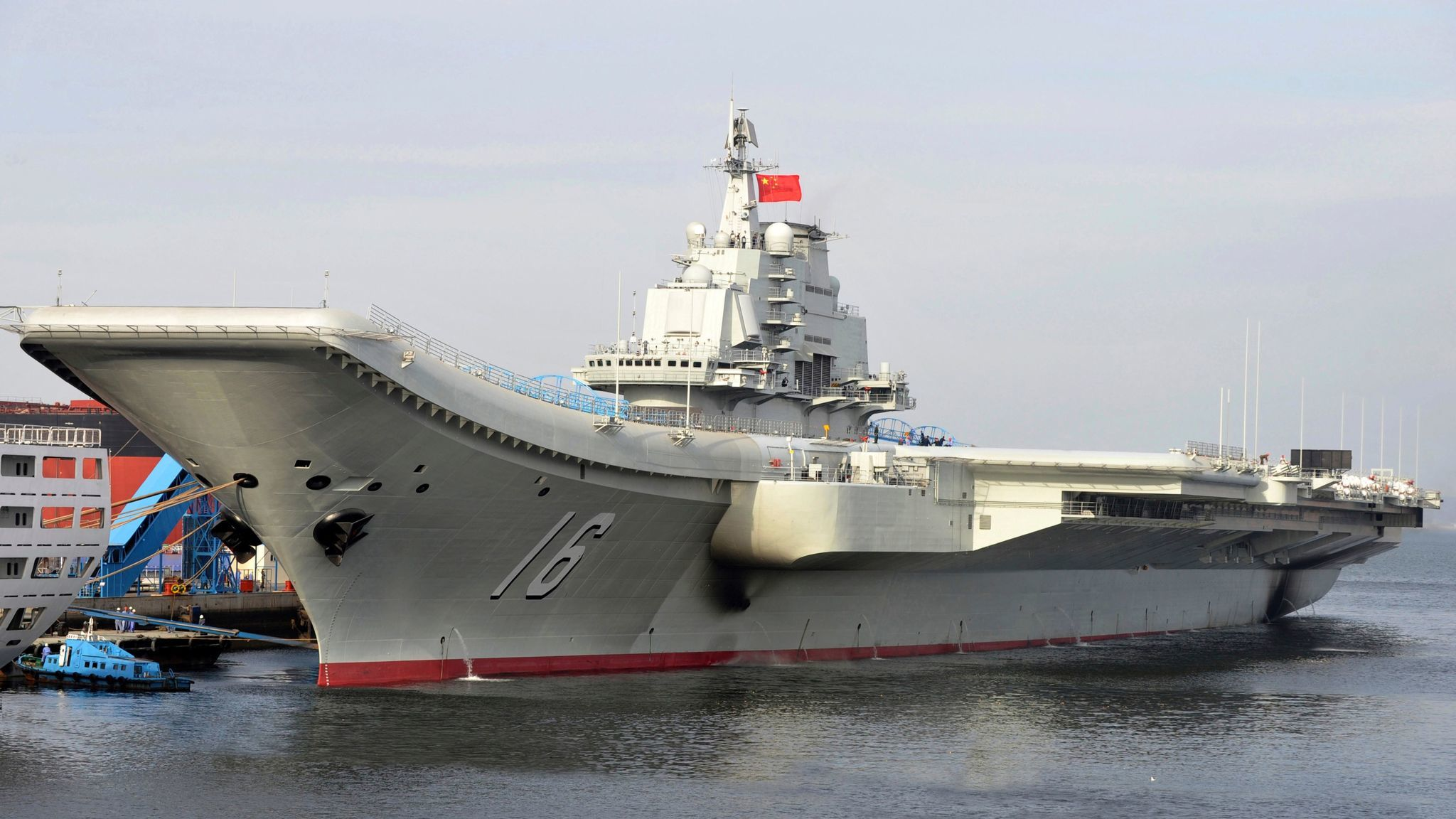 In this undated file photo released by China's Xinhua News Agency, China's aircraft carrier Liaoning berths in a Chinese port.