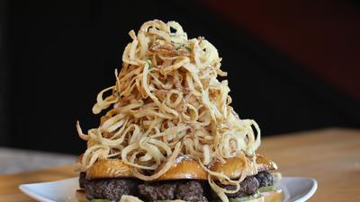 Onion straws top the 3.6.9. mini burgers with a choice of Gouda, mozzarella or Gorgonzola at Matchbo