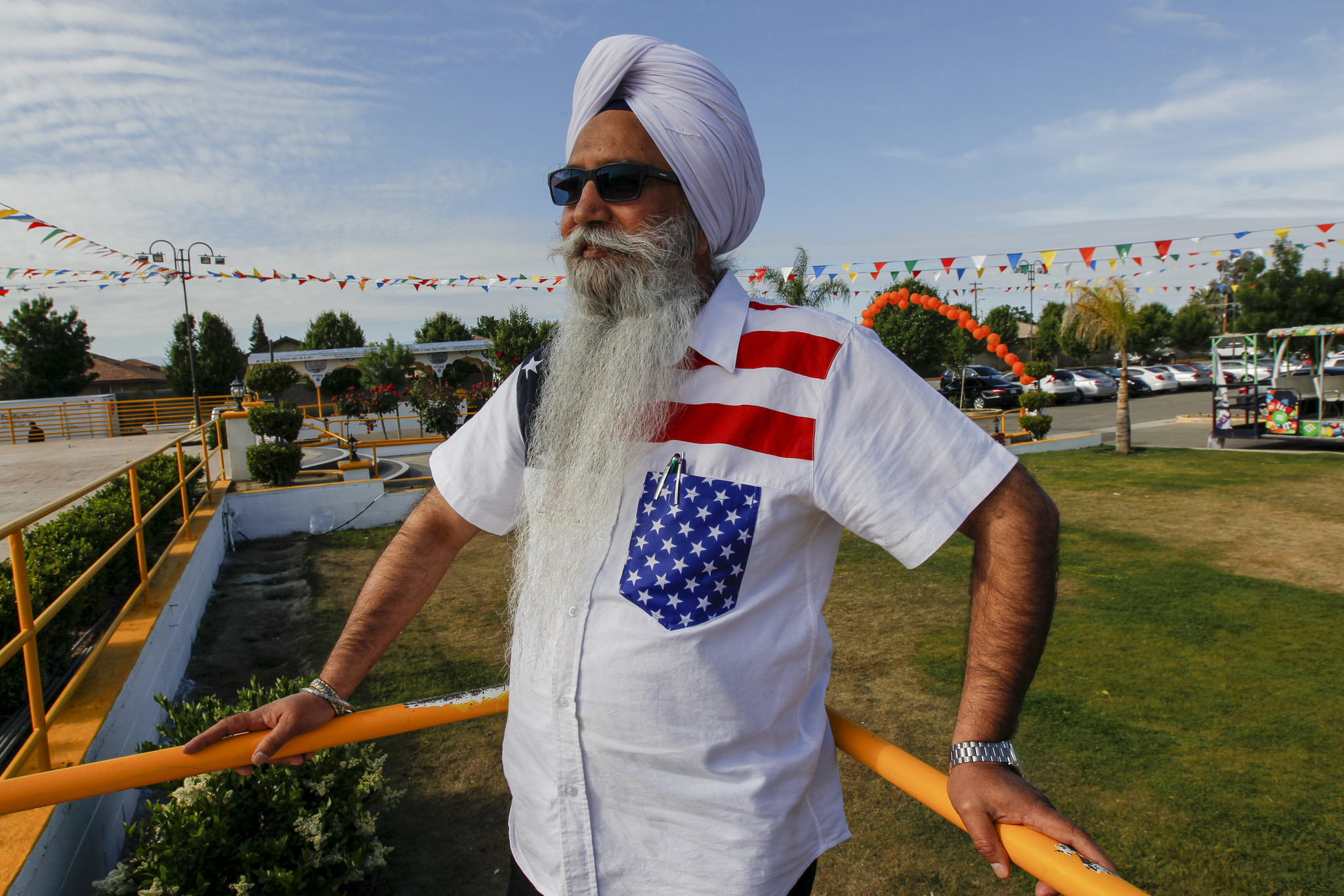 Gurcharan Singh, 63, celebrates a holiday parade at his gurdwara.