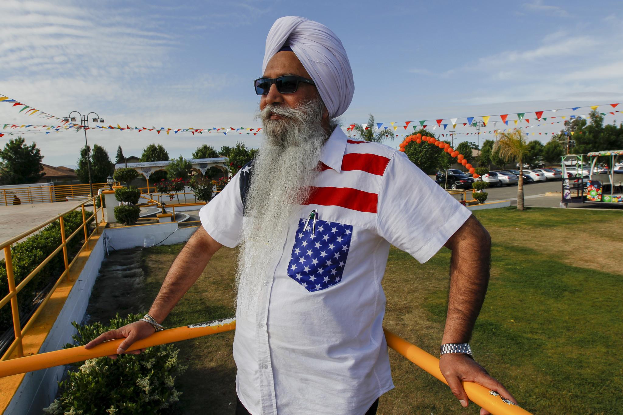 Gurcharan Singh, 63, celebrates a holiday parade at his gurdwara.