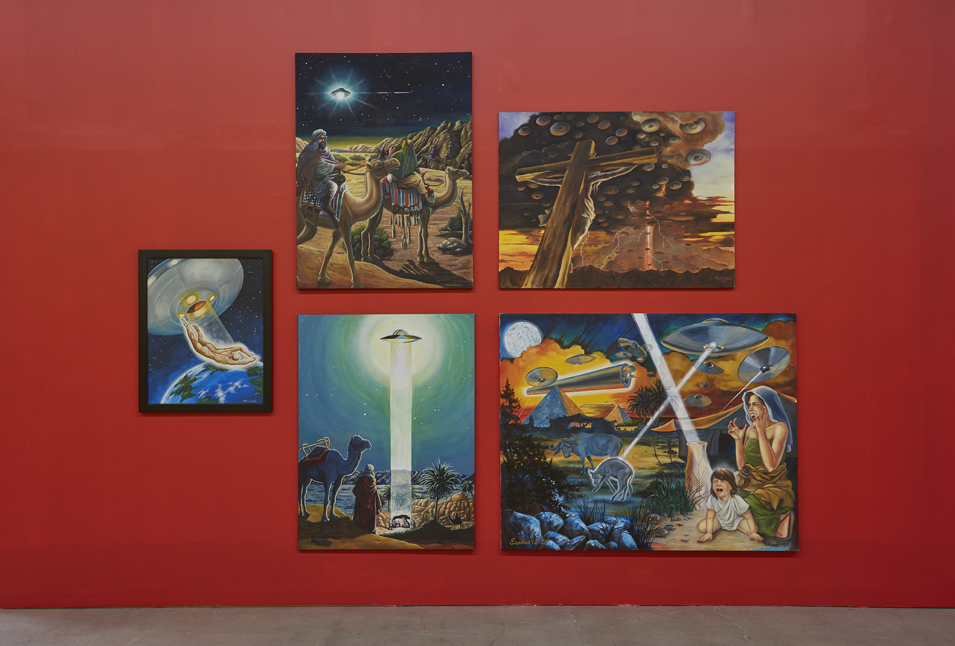 An installation of paintings by Monarca Lynn Merrifield, who claims to be a UFO contactee.