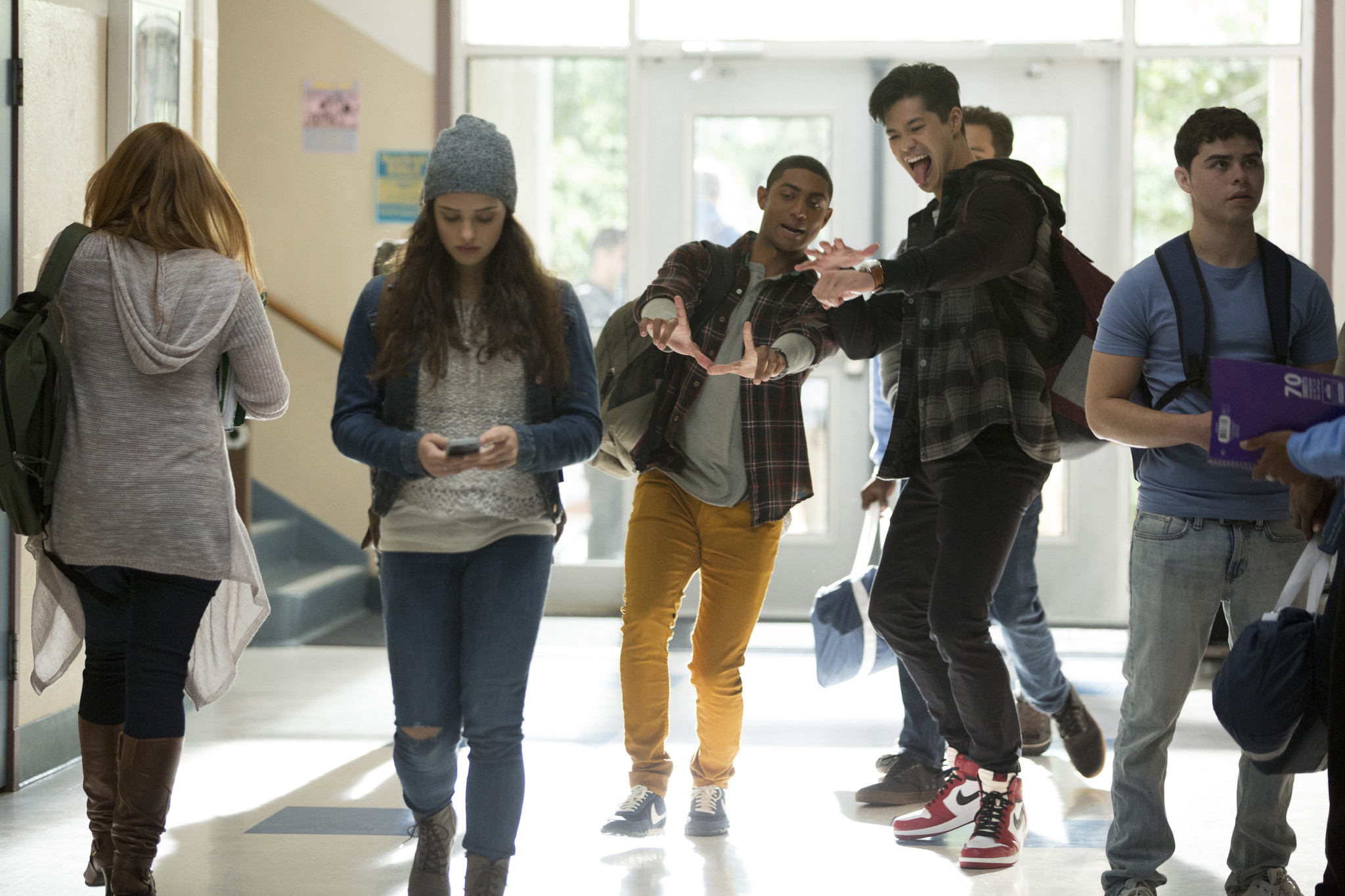 Katherine Langford (as Hannah Baker) is teased in her school's hallways in a scene from