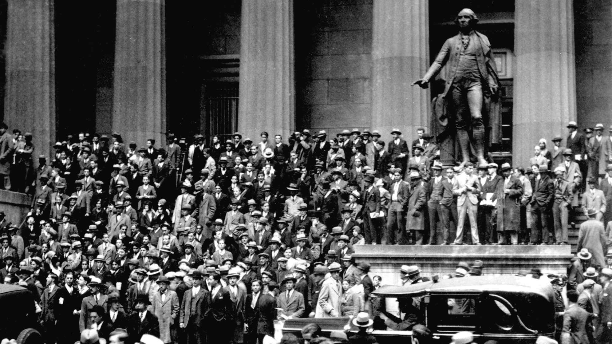 People gather across the street from the New York Stock Exchange in New York on Oct. 24, 1929. On Oct. 28, the Dow dropped 13% on what would be called Black Monday. It fell another 13% the next day, Black Tuesday.