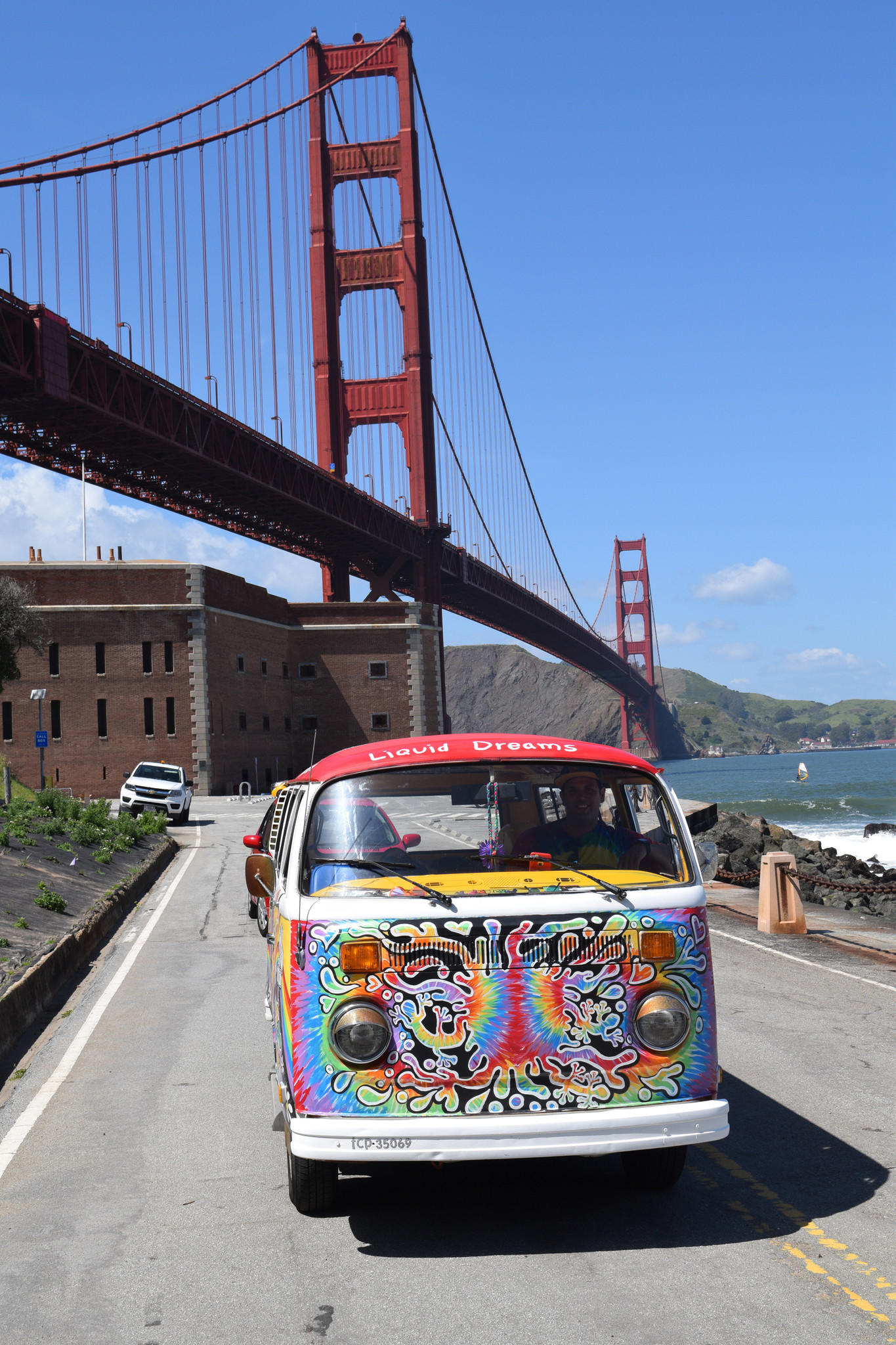 The brilliantly painted VW van of San Francisco Love Tours makes a stop at the Golden Gate Bridge. The tour, run by Allan Graves, covers much of the city in 2 1/2 hours, including the Haight-Ashbury District and other locales important to the Summer of Love.