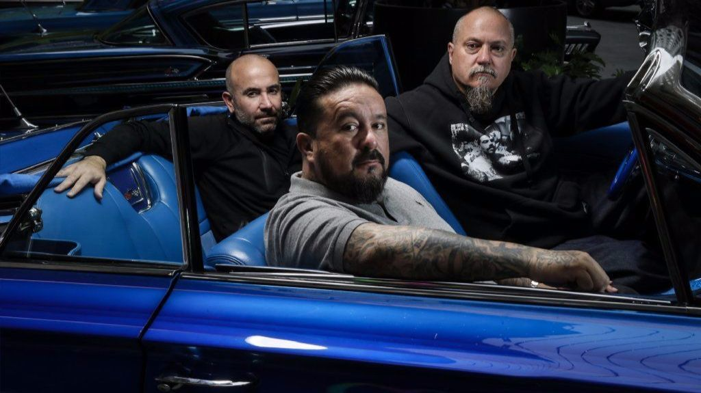 "Mister Cartoon, center, is flanked by Estevan Oriol, right, and Ricardo de Montreuill, of ""Lowriders."""
