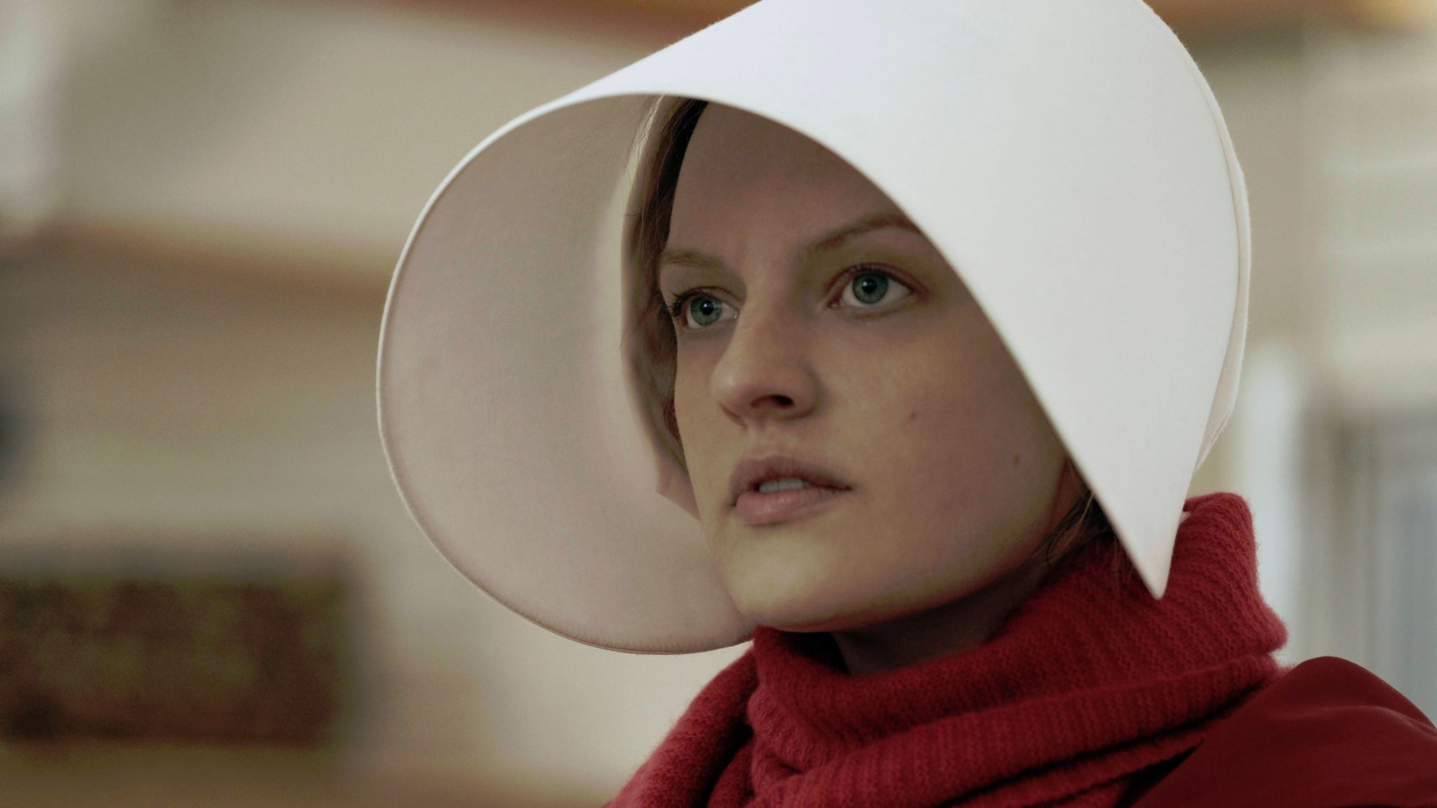 Elisabeth Moss as Offred on