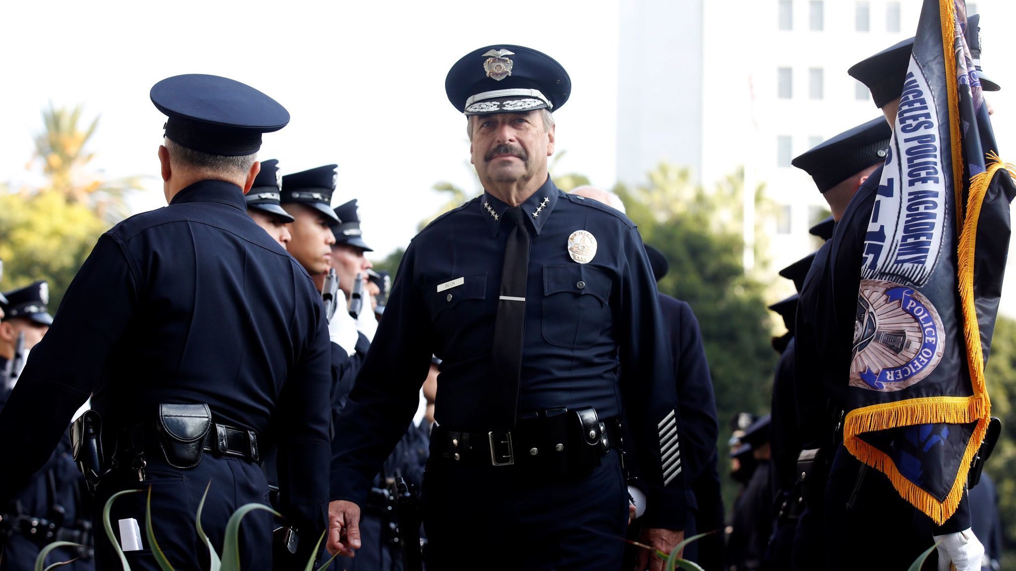 LAPD Chief Charlie Beck appears at a 2015 graduation ceremony for new LAPD officers.