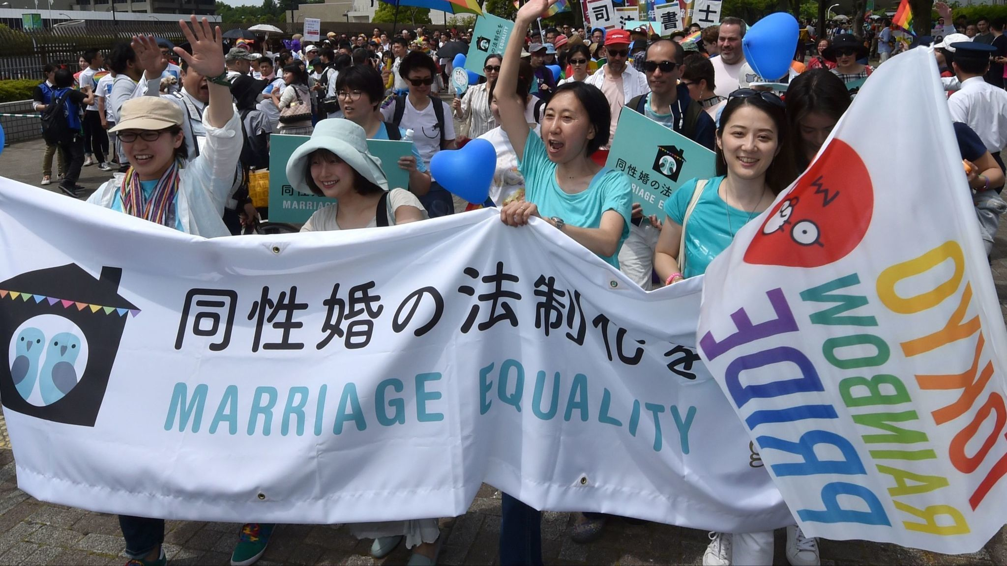 People march in the Rainbow Pride parade in Tokyo on May 7, 2017.