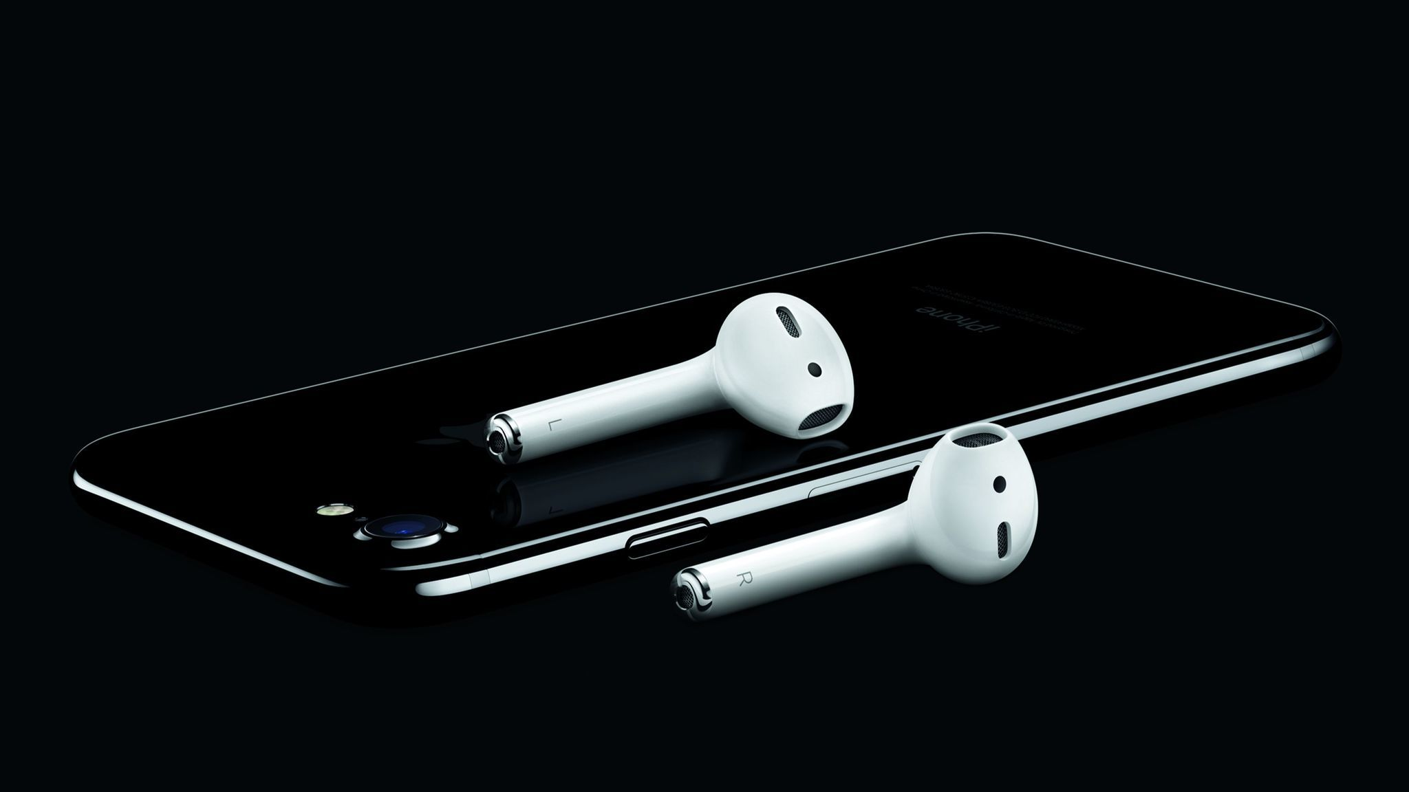 An iPhone 7 with wireless AirPods.
