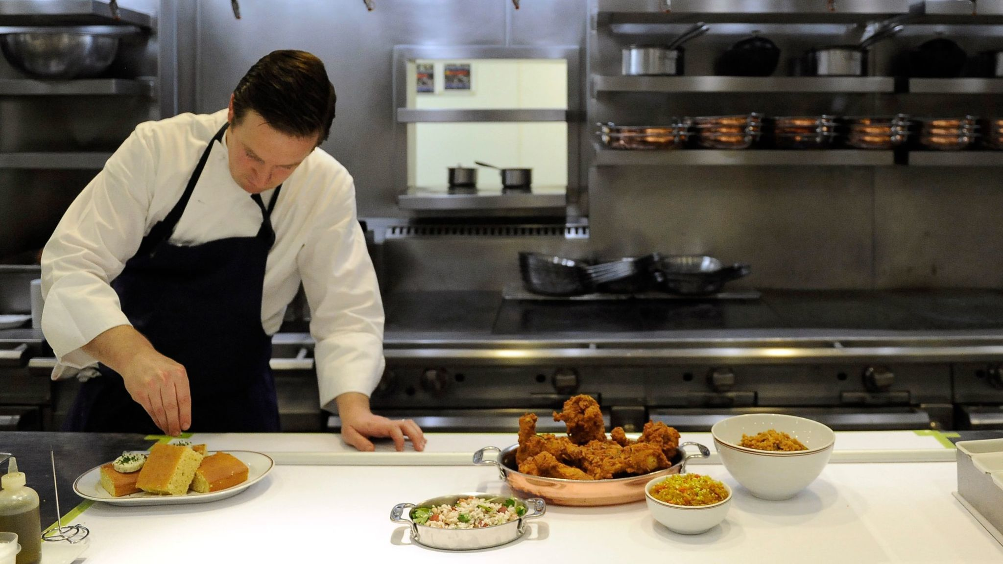 Bouchon chef de cuisine David Hodson puts the finishing touches on Bouchon's Monday fried chicken night special.