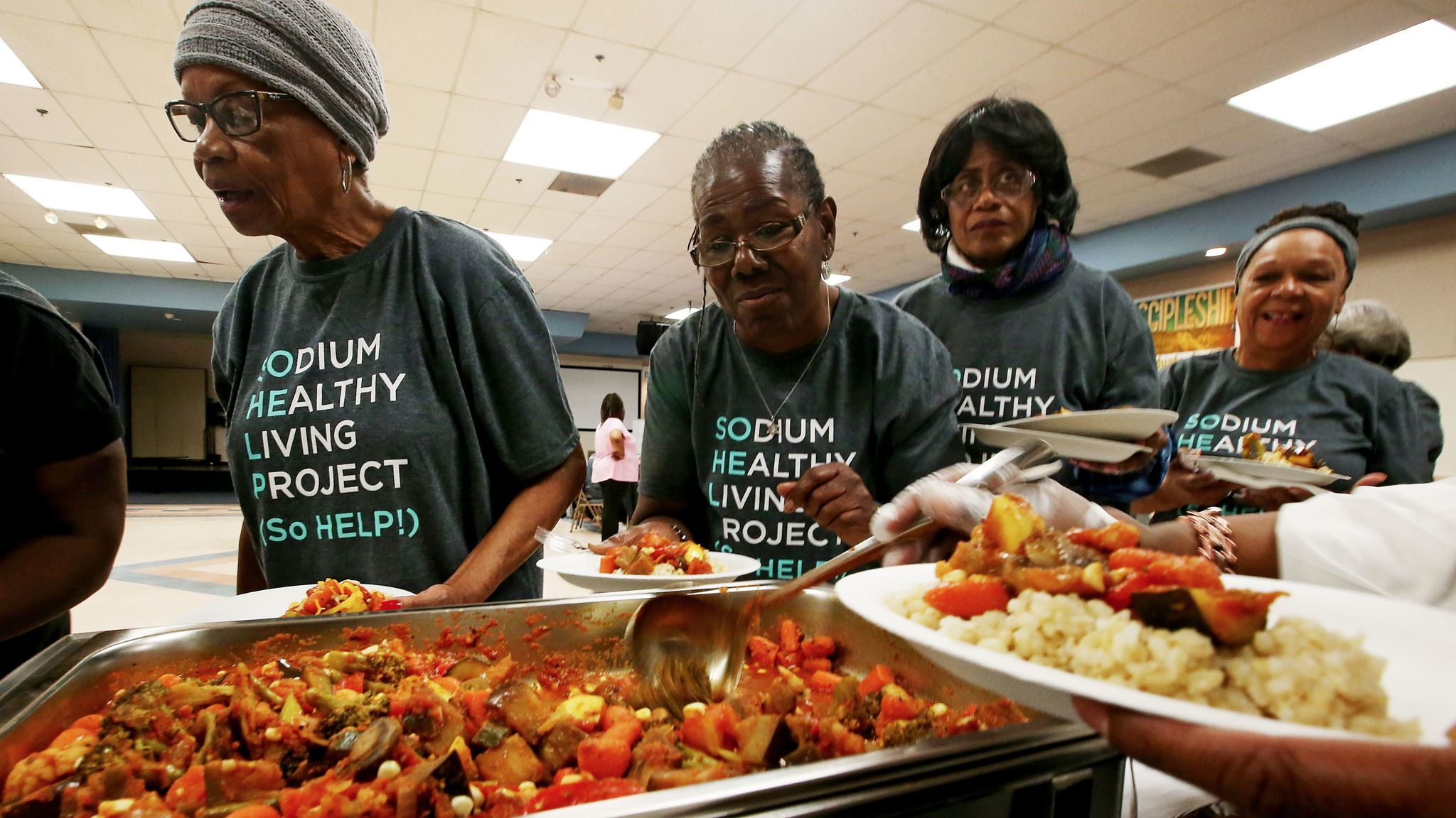 Participants in the Sodium Healthy Living Project line up for a low-sodium, vegetarian dinner at Holman Methodist Church in Los Angeles.